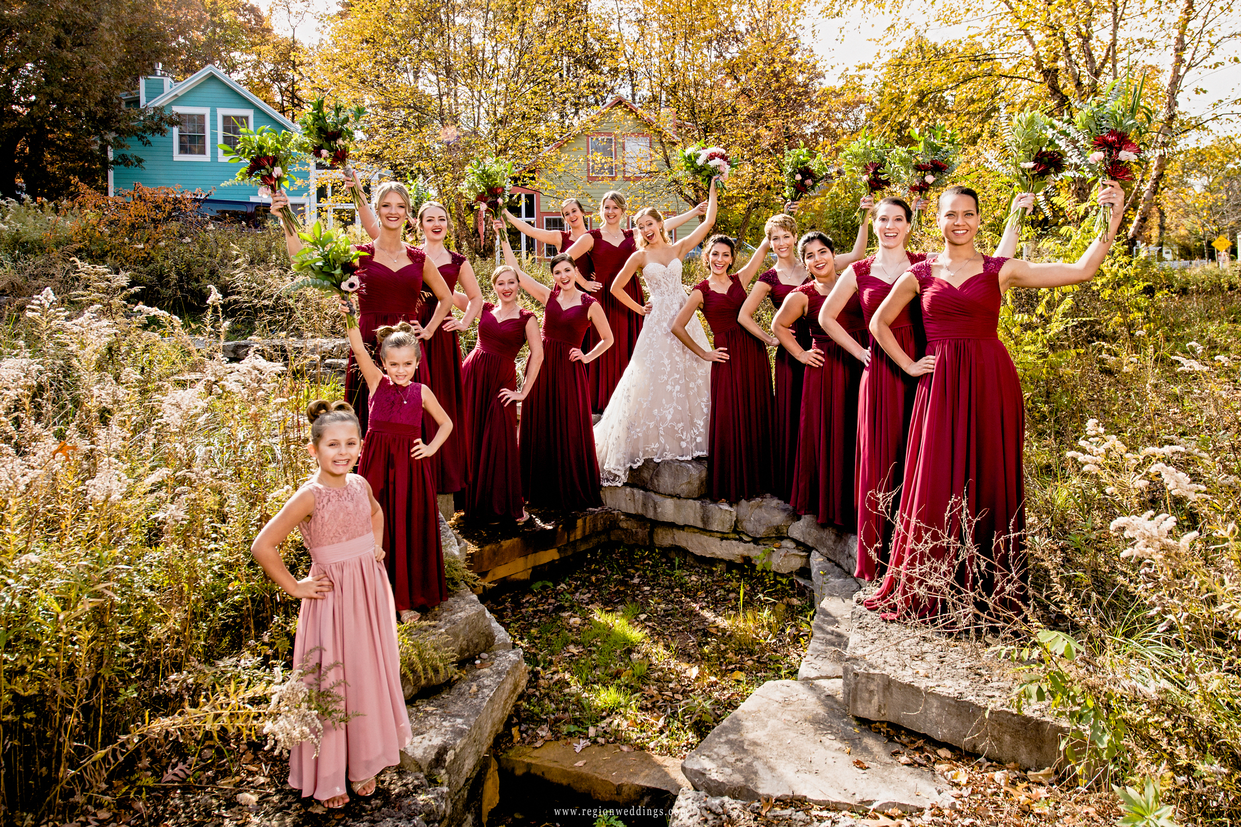 The bride and her bridesmaids cheer.