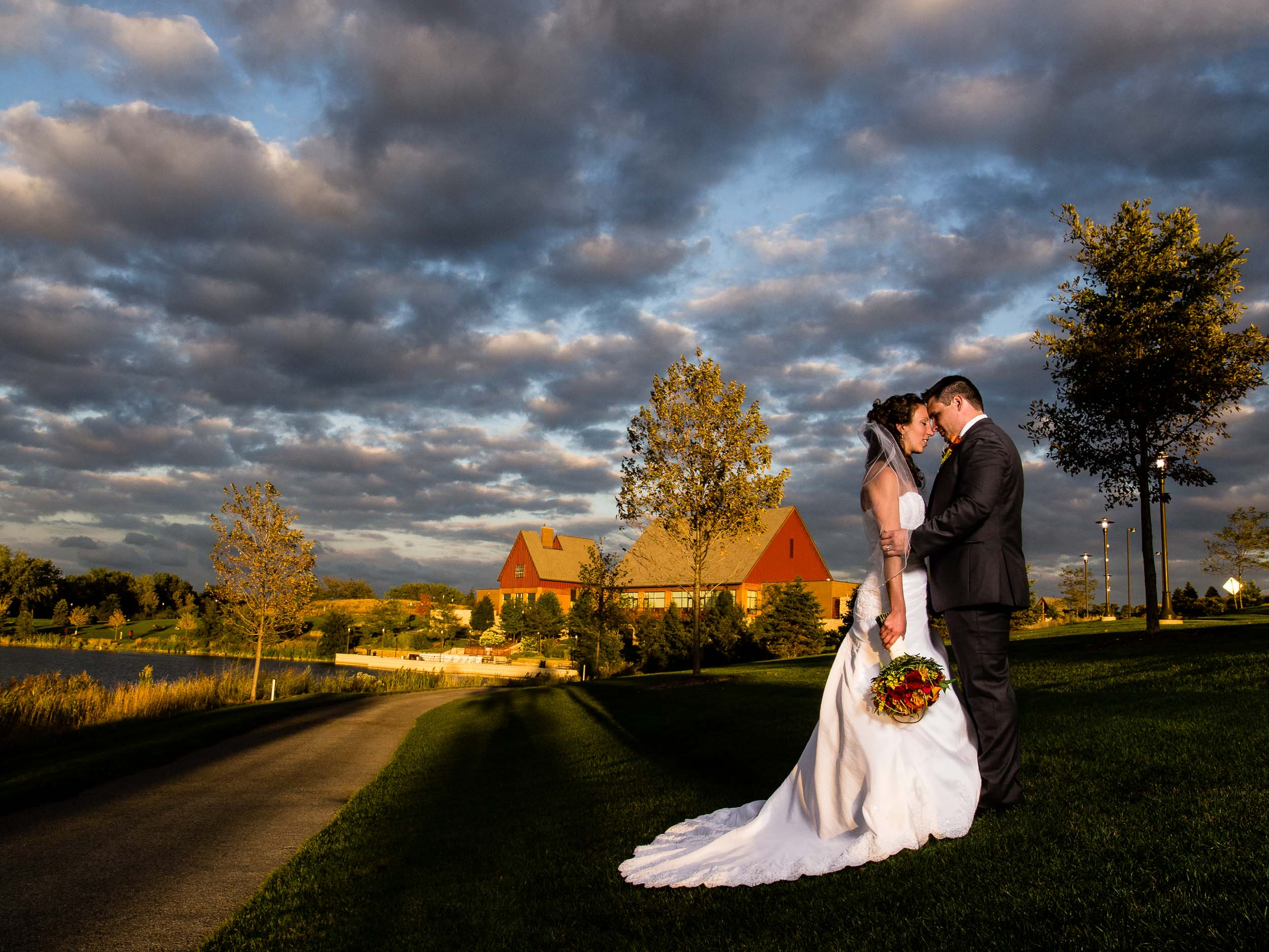 Bride and groom embrace at Centennial Park in Munster, Indiana.