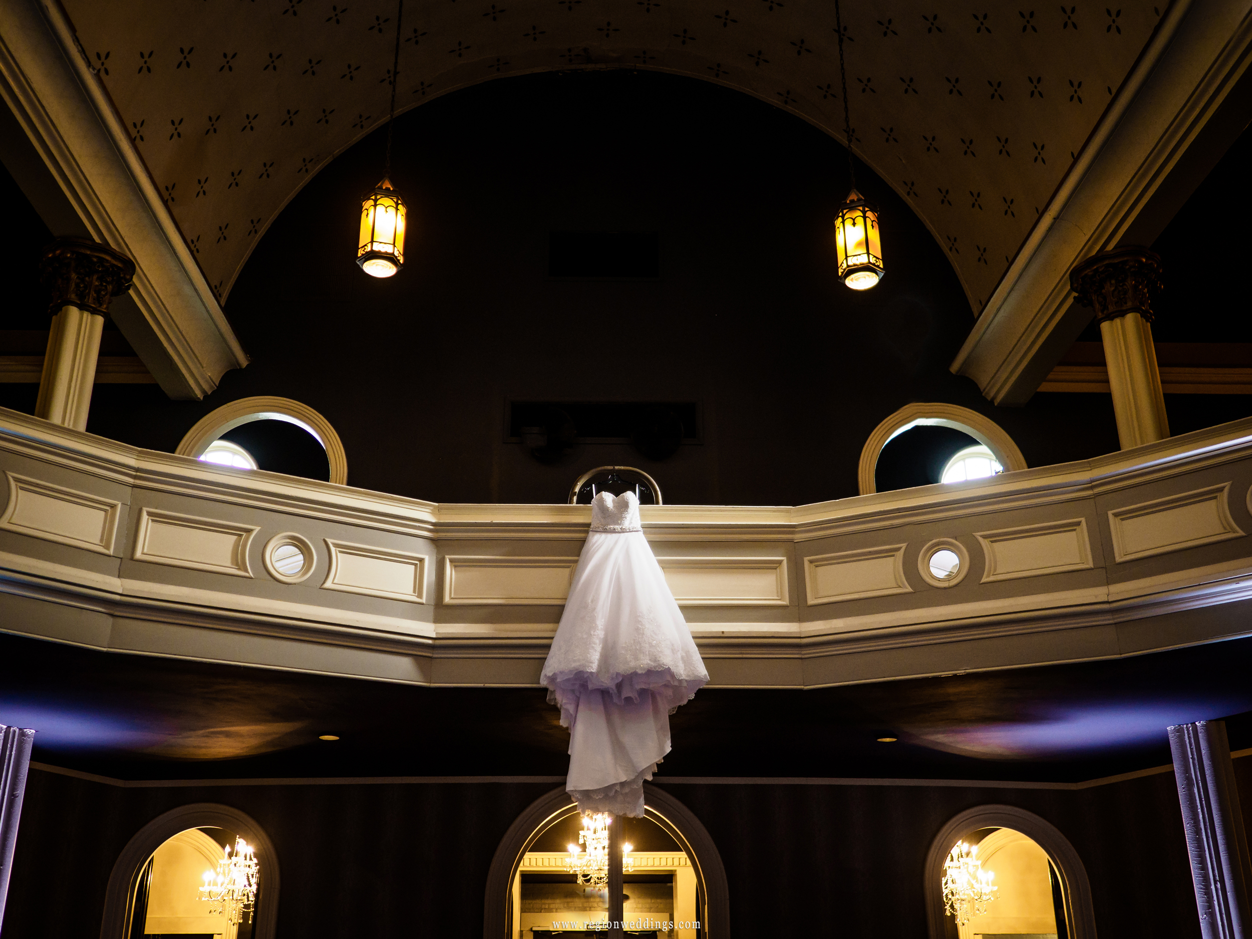 Wedding dress hangs from the balcony at Uptown Center.