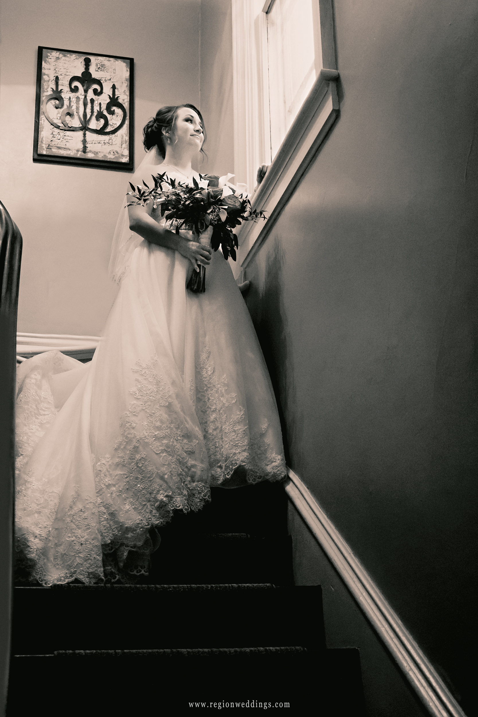 The bride descends from the loft at The Uptown Center in Michigan City, Indiana.