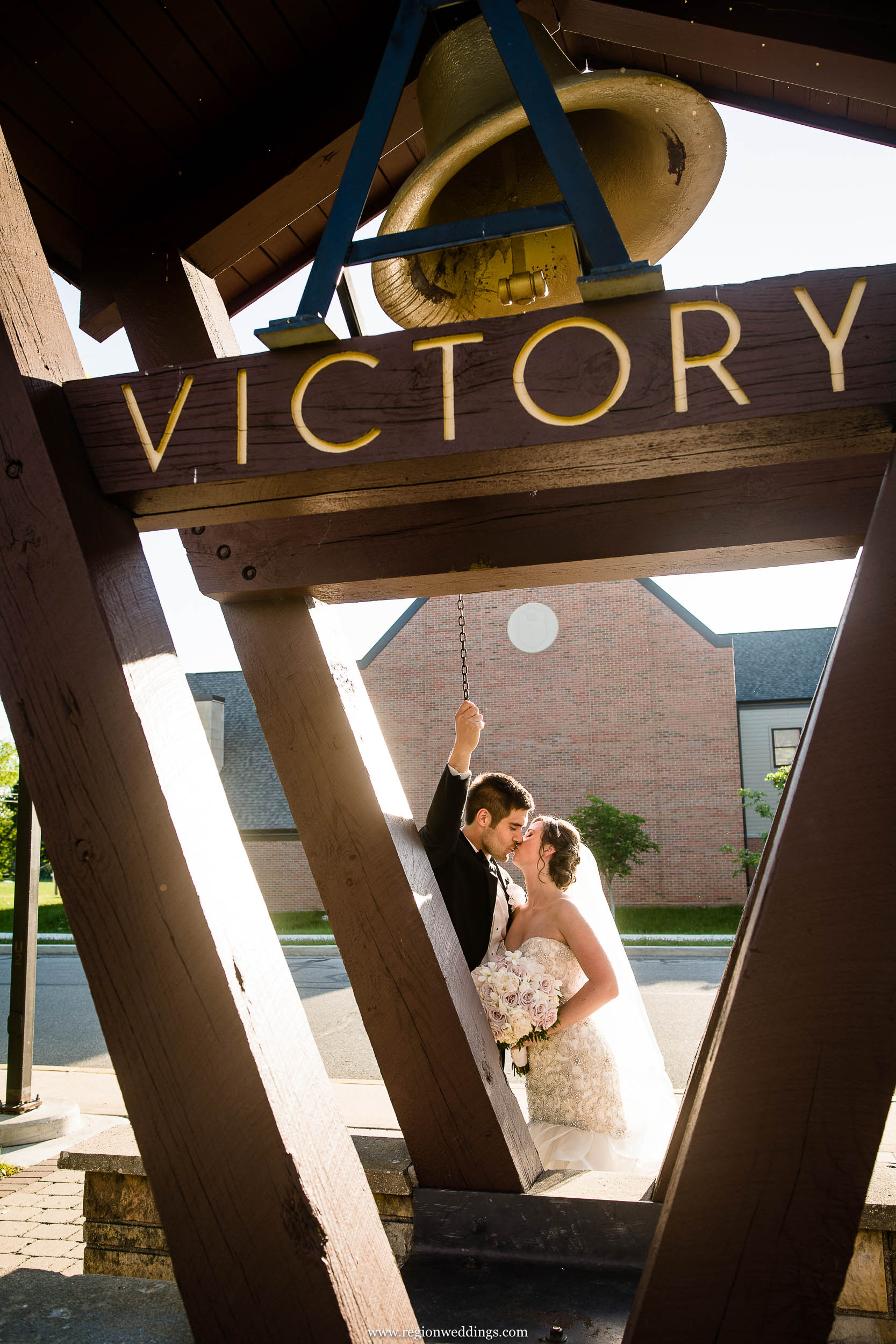 The groom rings the victory bell at Valparaiso University.