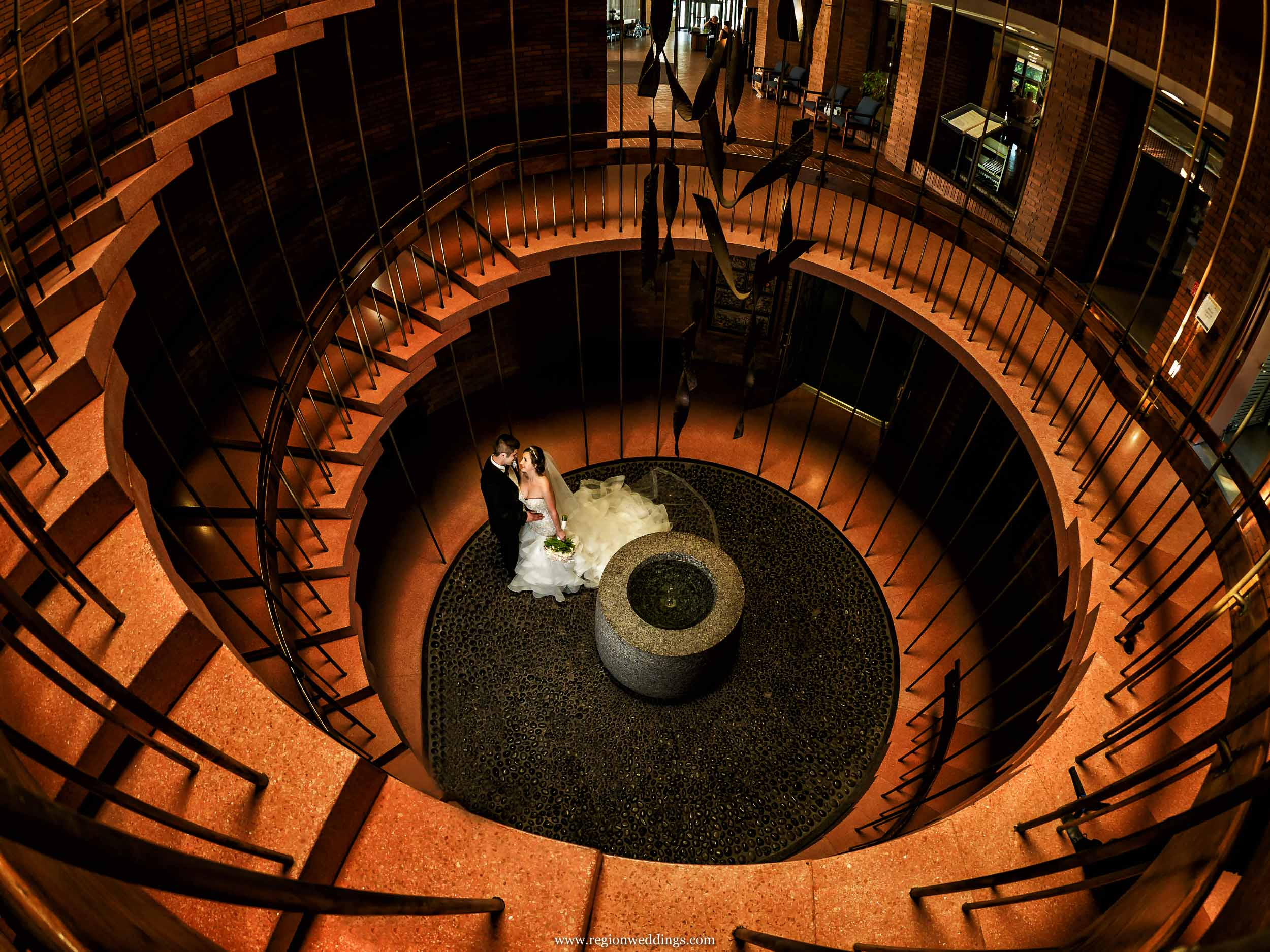 Bride and groom at the bottom of the spiral staircase at Valparaiso University.