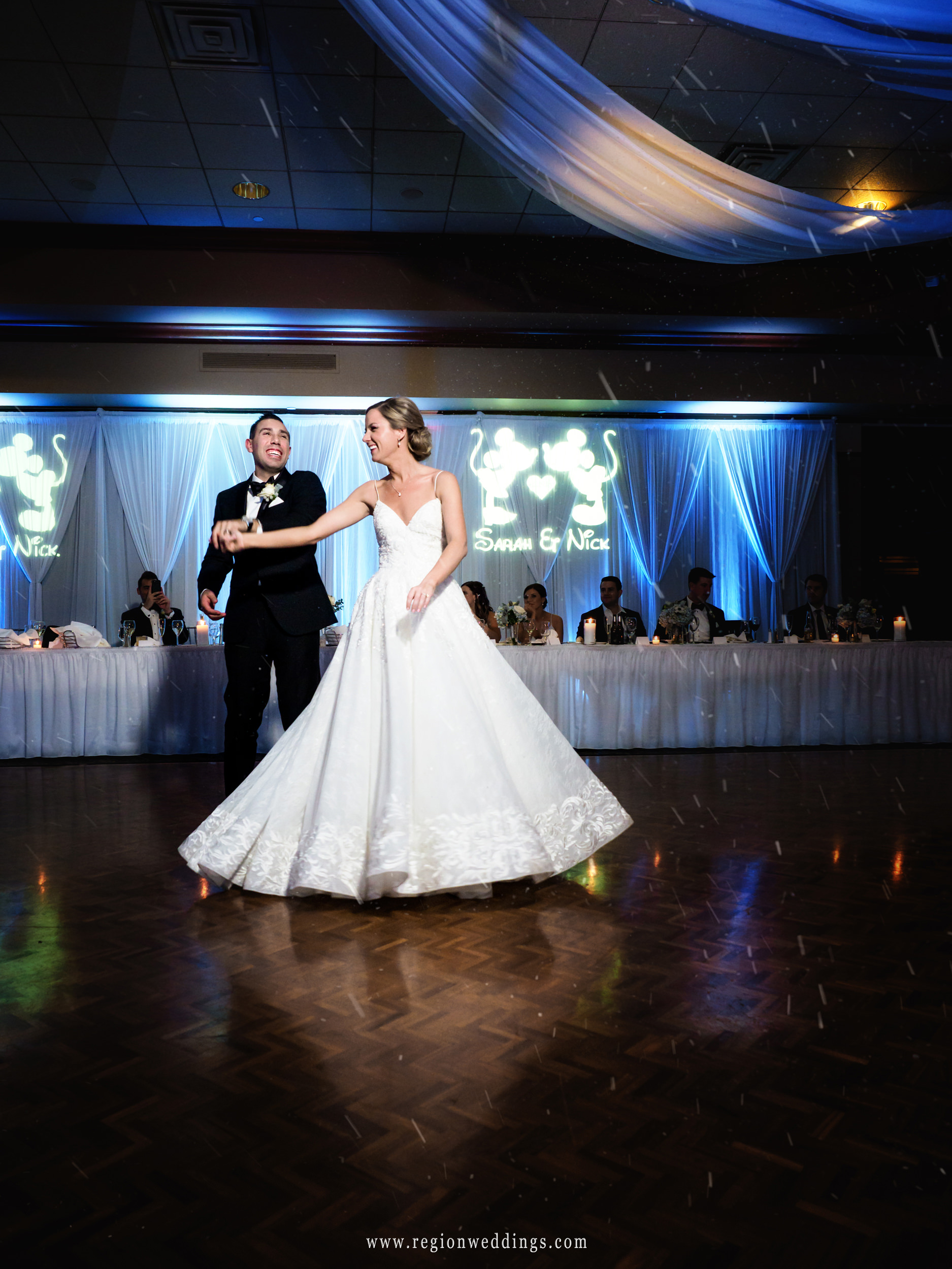 First dance for the bride and groom as snow falls upon them.