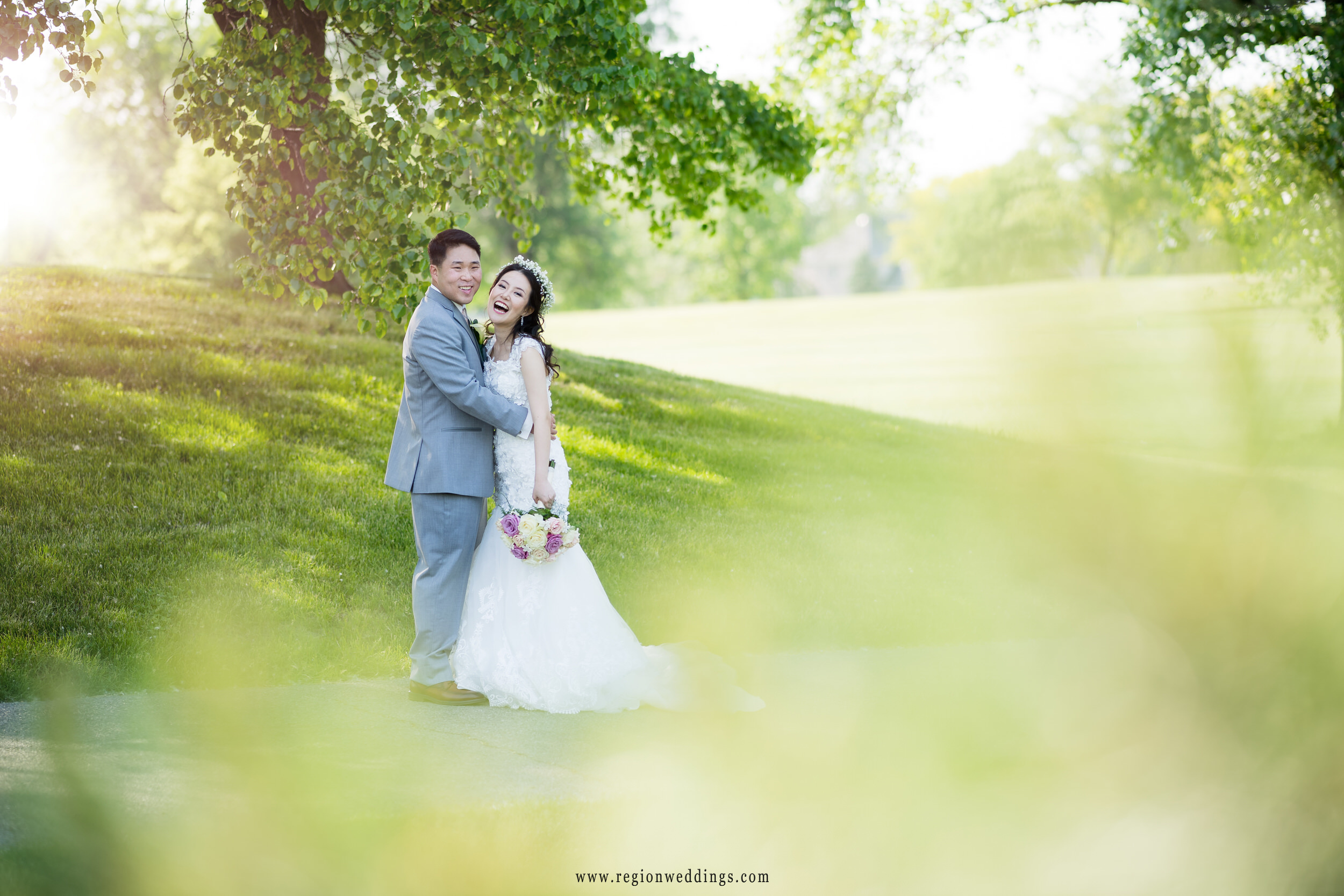 The bride and groom share a laugh at Briar Ridge Country Club.