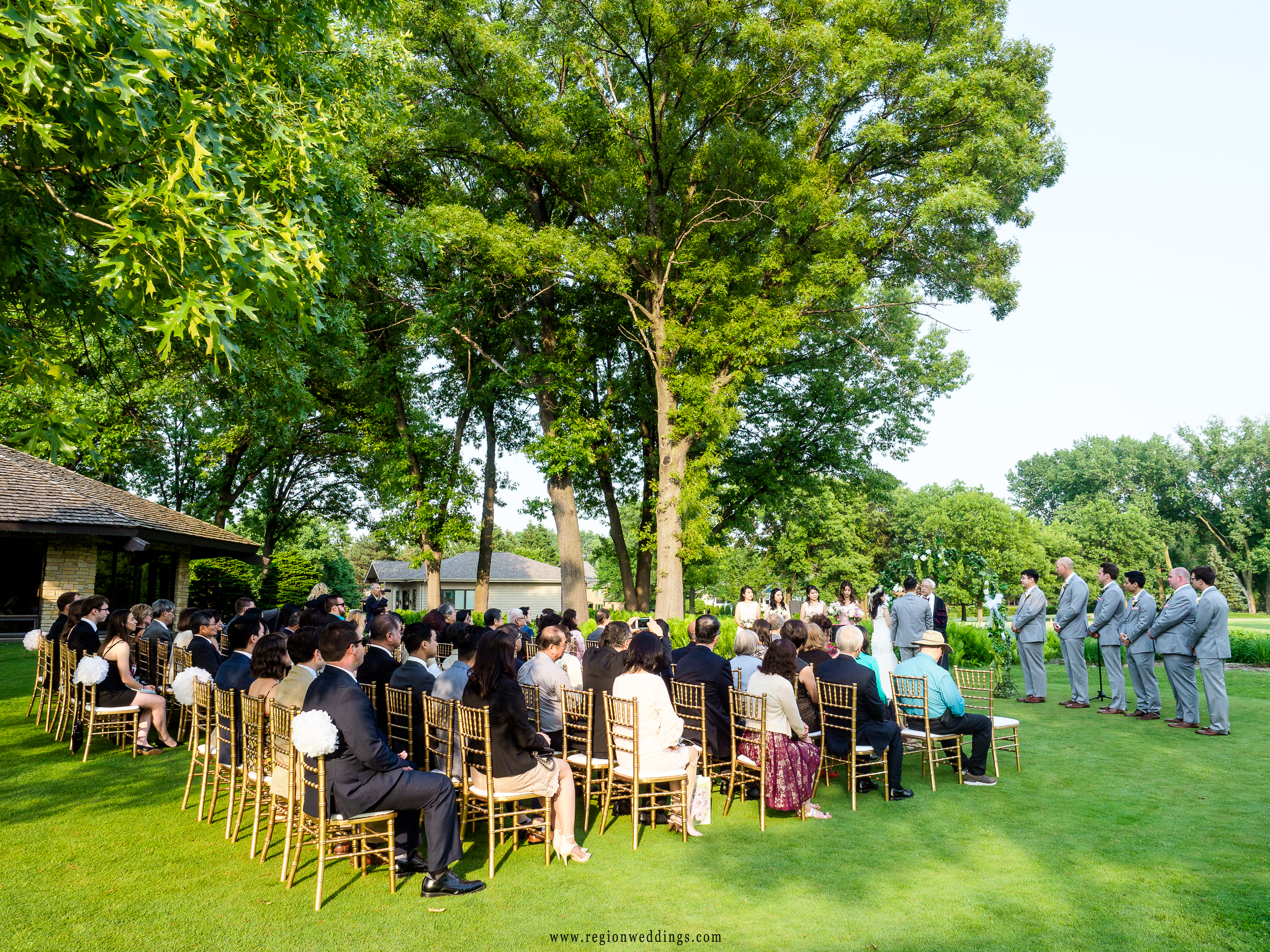 Outdoor summer wedding on the golf course.