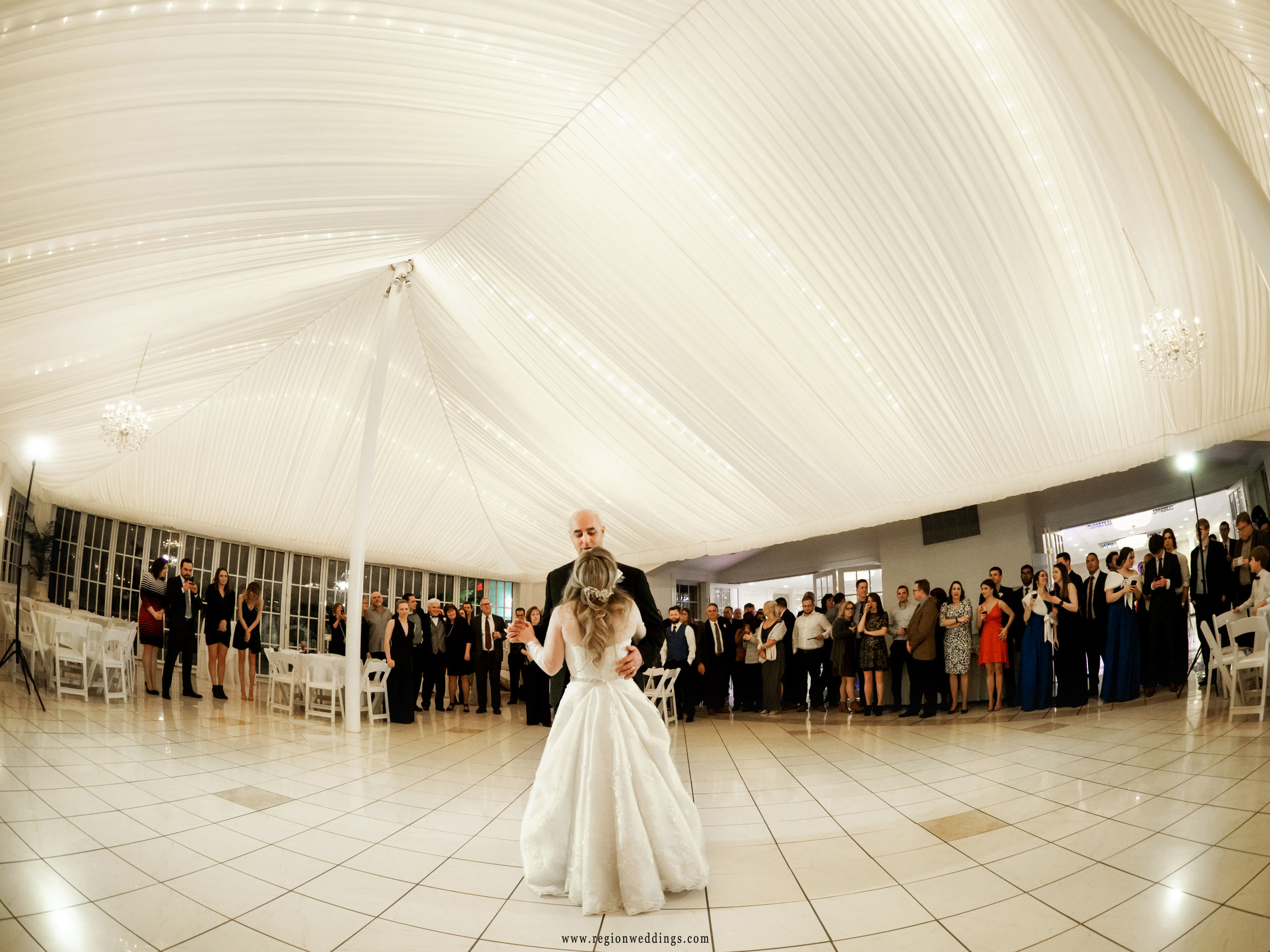 First dance for the newlyweds as friends and family surround them on the dance floor at Chateau Bu-Sché.
