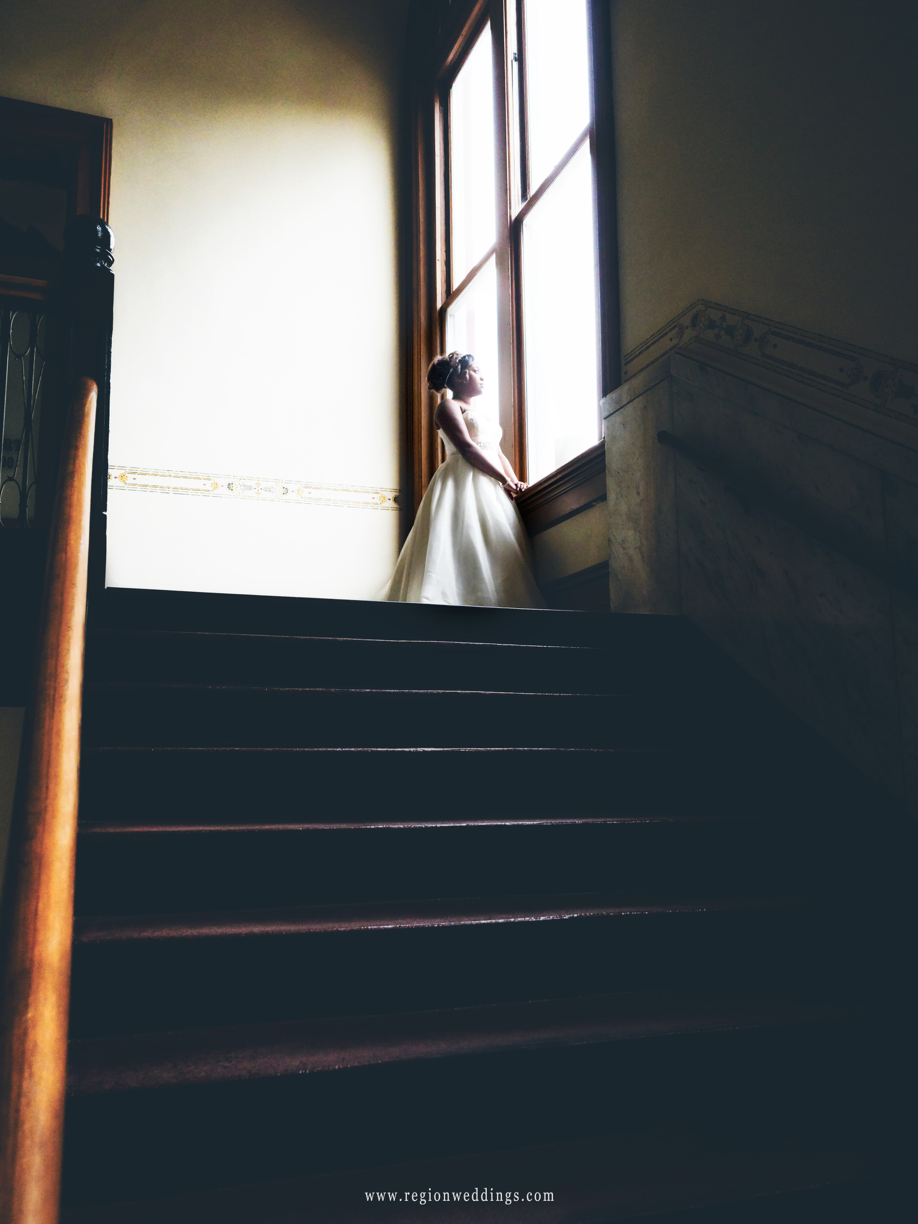 Bride at the top of the staircase at the old Crown Point Courthouse.