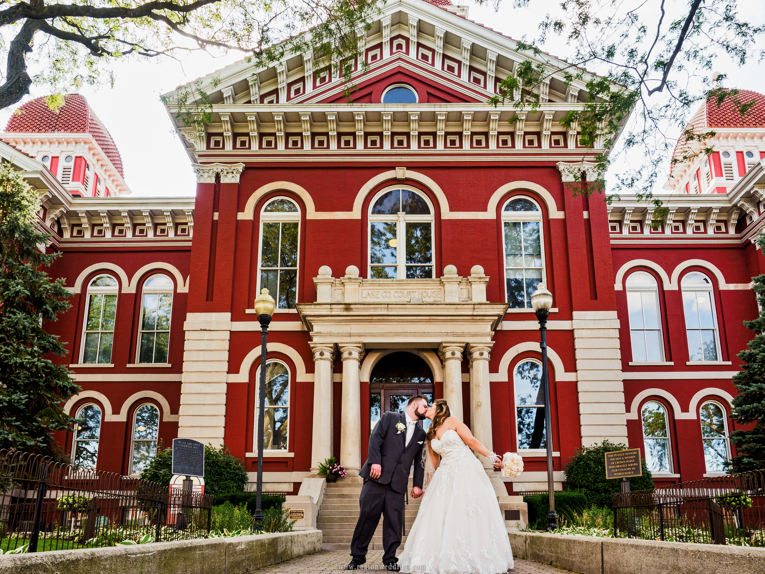 Bride and groom kiss in front of the Grand Old Lady in downtown Crown Point.