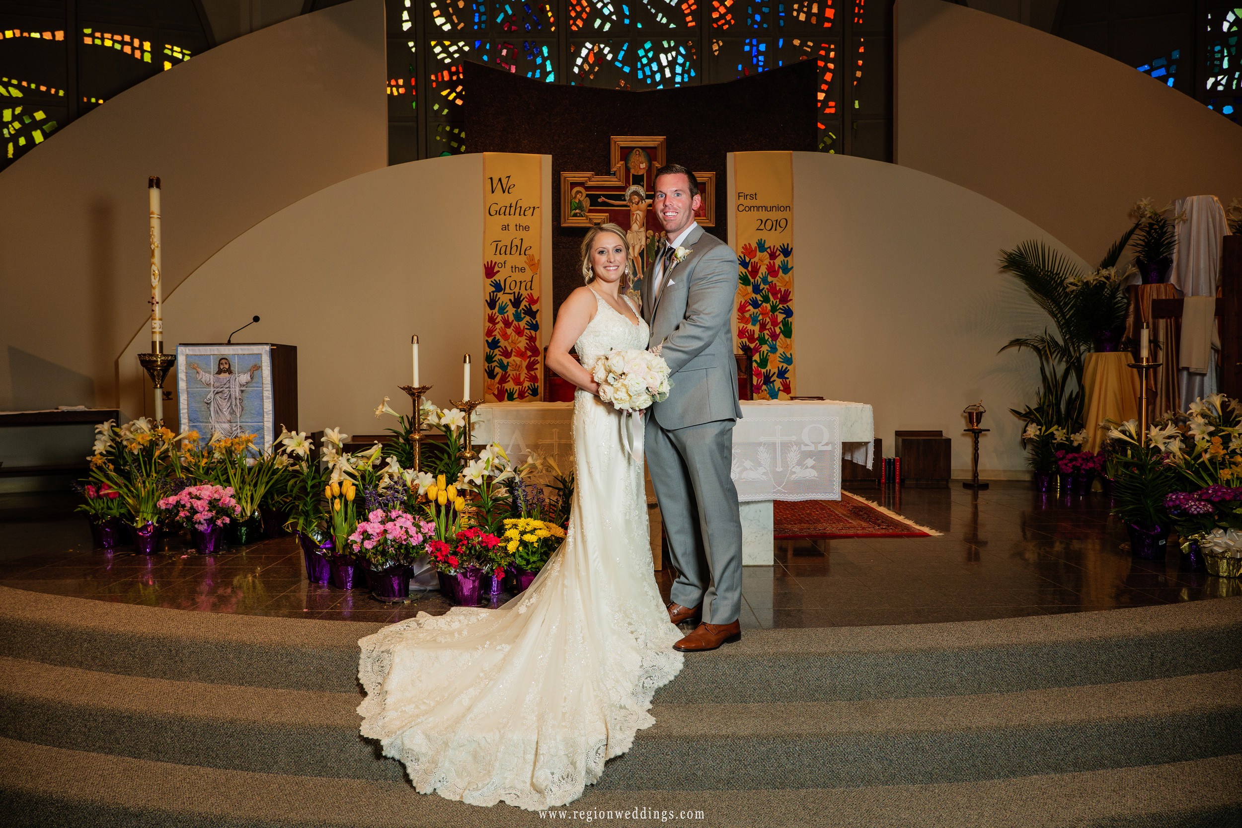 Bride and groom on the altar at St. Paul Catholic Church in Valparaiso, Indiana.