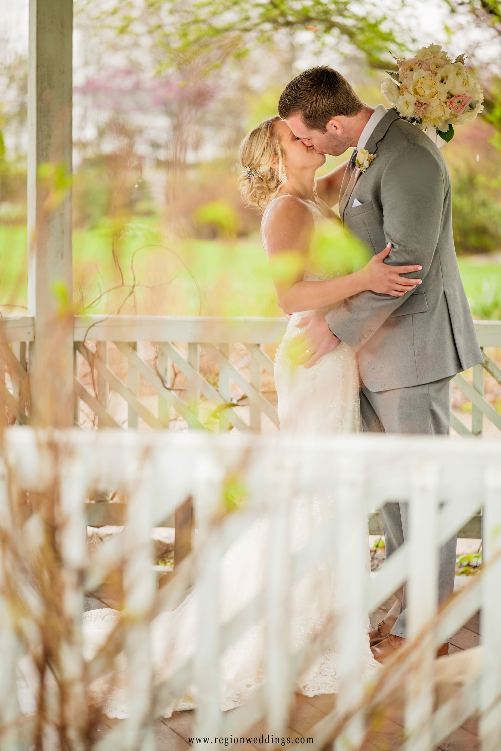 Kissing underneath the gazebo at Ogden Garden.
