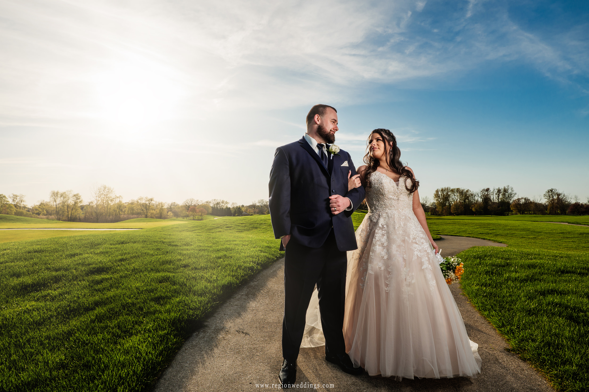 A romantic stroll on the Sand Creek golf course as the sun shines brightly.