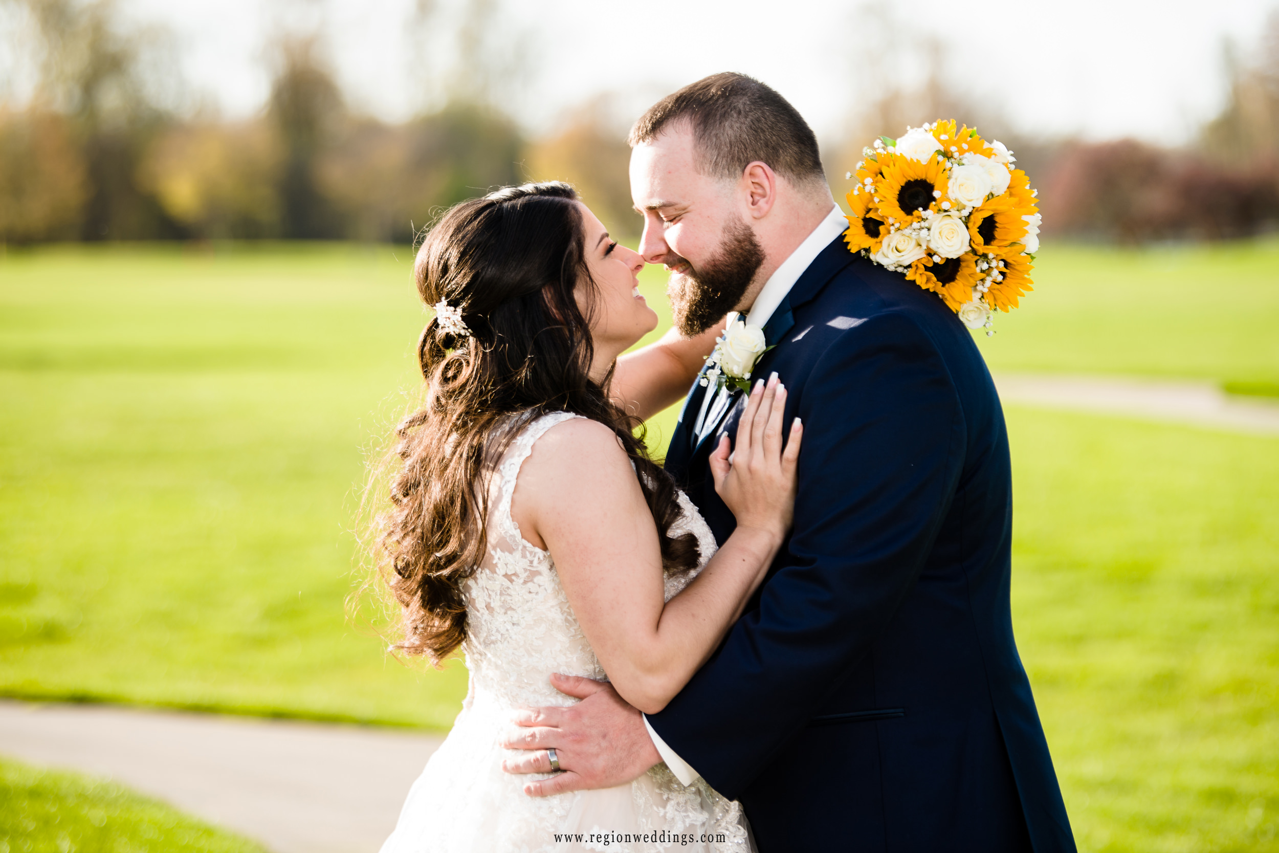 The bride and groom nuzzle noses for their Spring wedding photos.