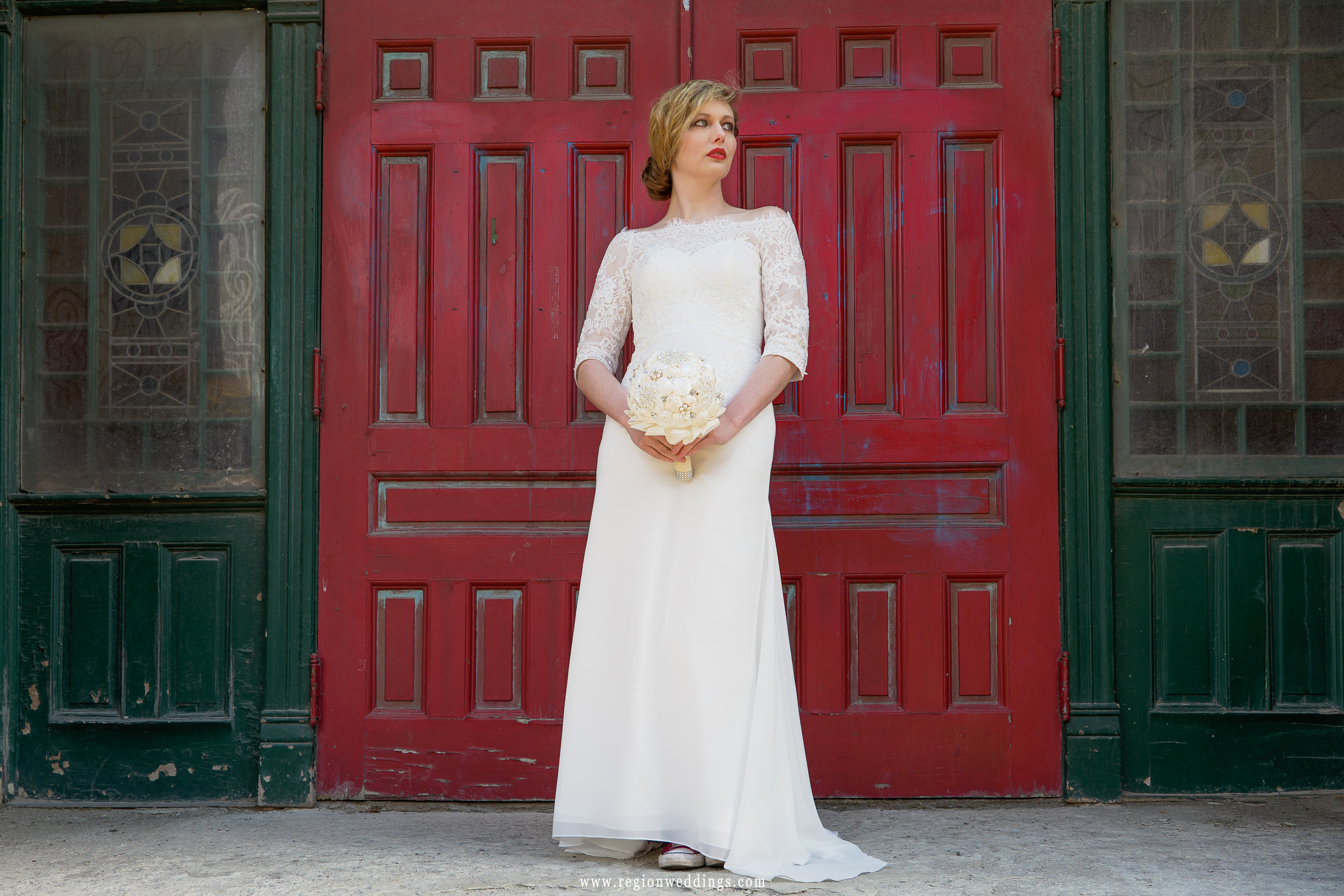 Bridal portrait in front of a grungy red door in Chicago.