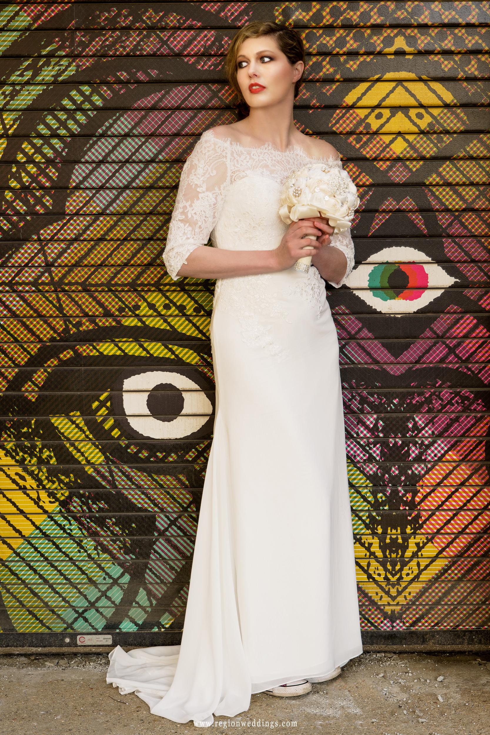 Bridal portrait using a colorful garage door as a backdrop.