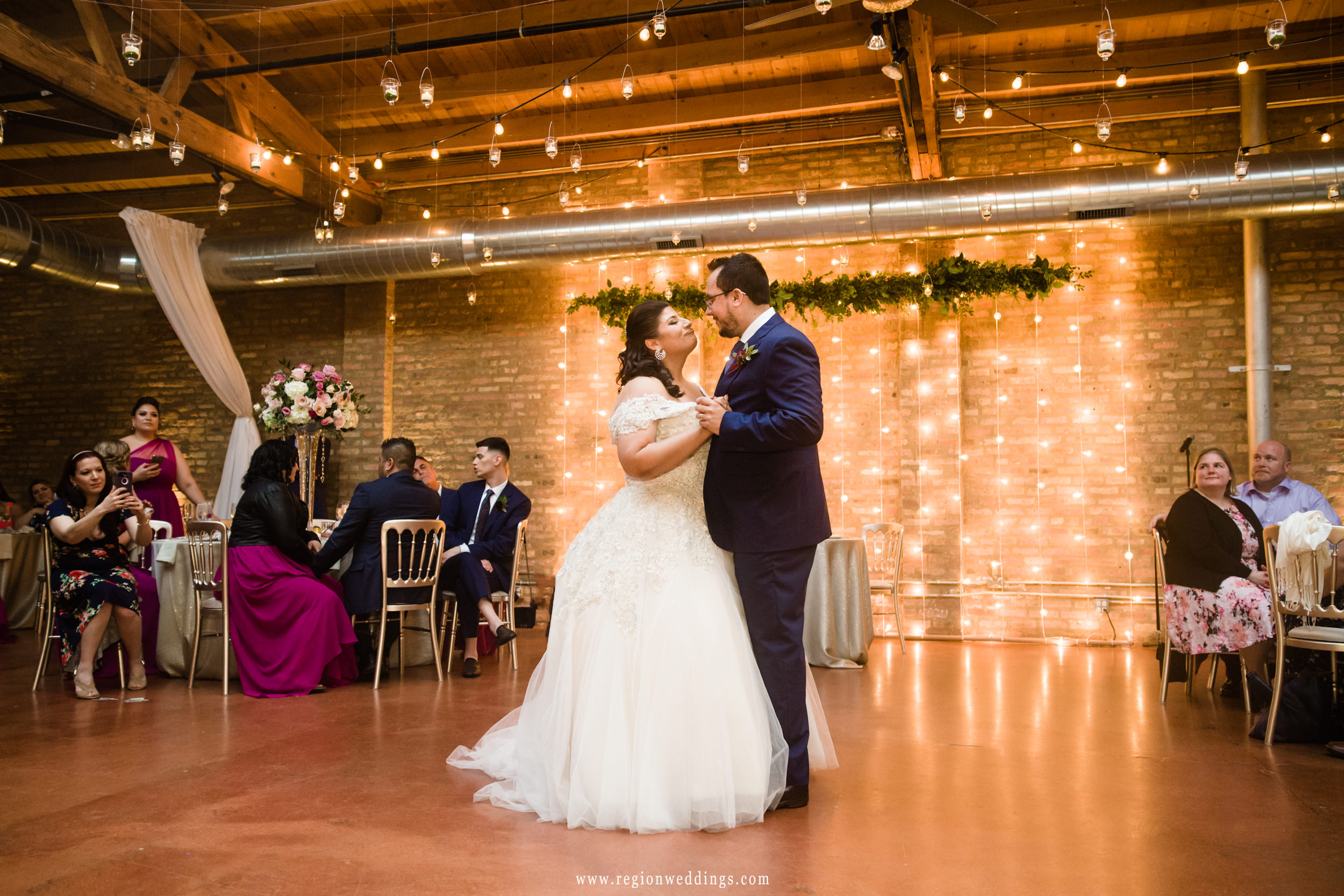 First dance for the bride and groom at Loft On Lake wedding venue in Chicago.