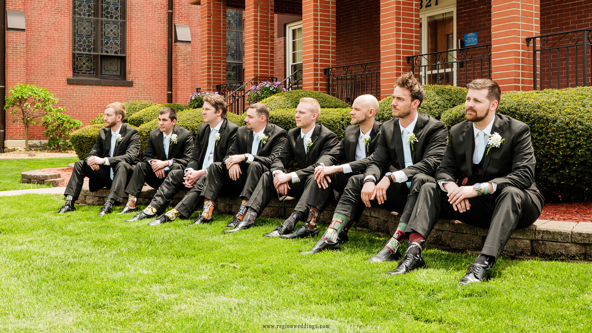 The groomsmen reveal their socks at Saint Mary's Catholic Church in Crown Point, Indiana.