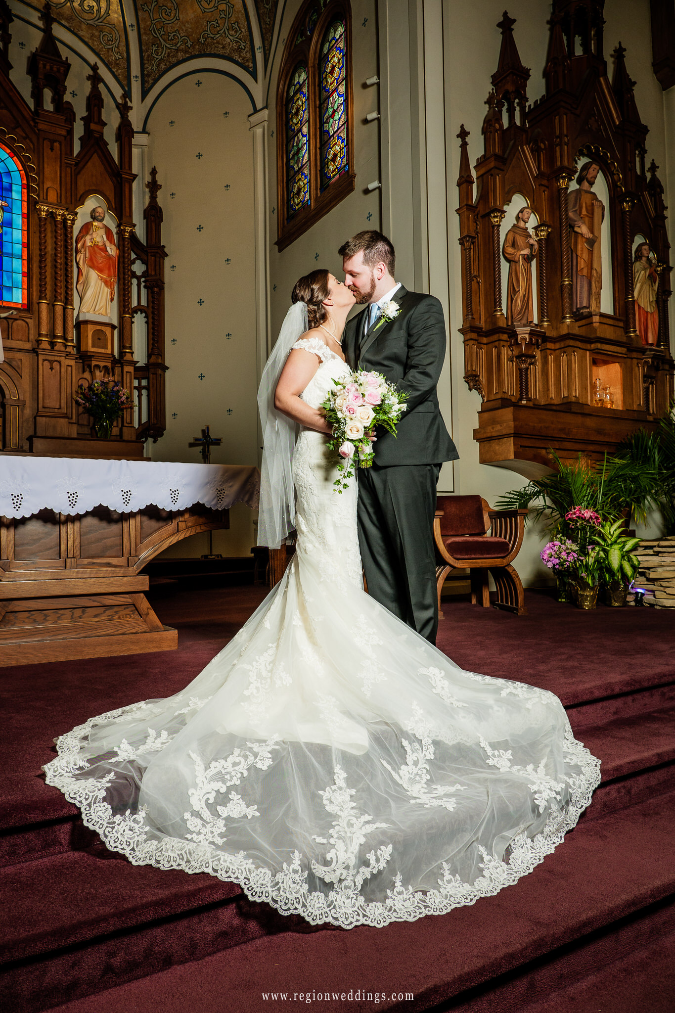 Bride and groom at the altar of Saint Mary's Church.