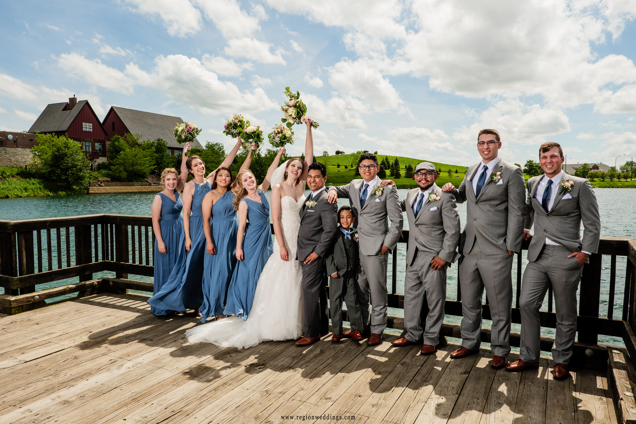 Wedding party enjoying the sunshine on the lake bridge at Centennial Park.