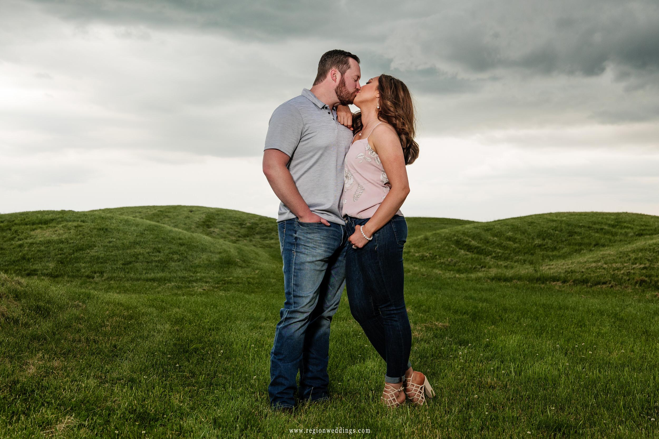 Romantic kiss amid the rolling hills of Gabis Arboretum.