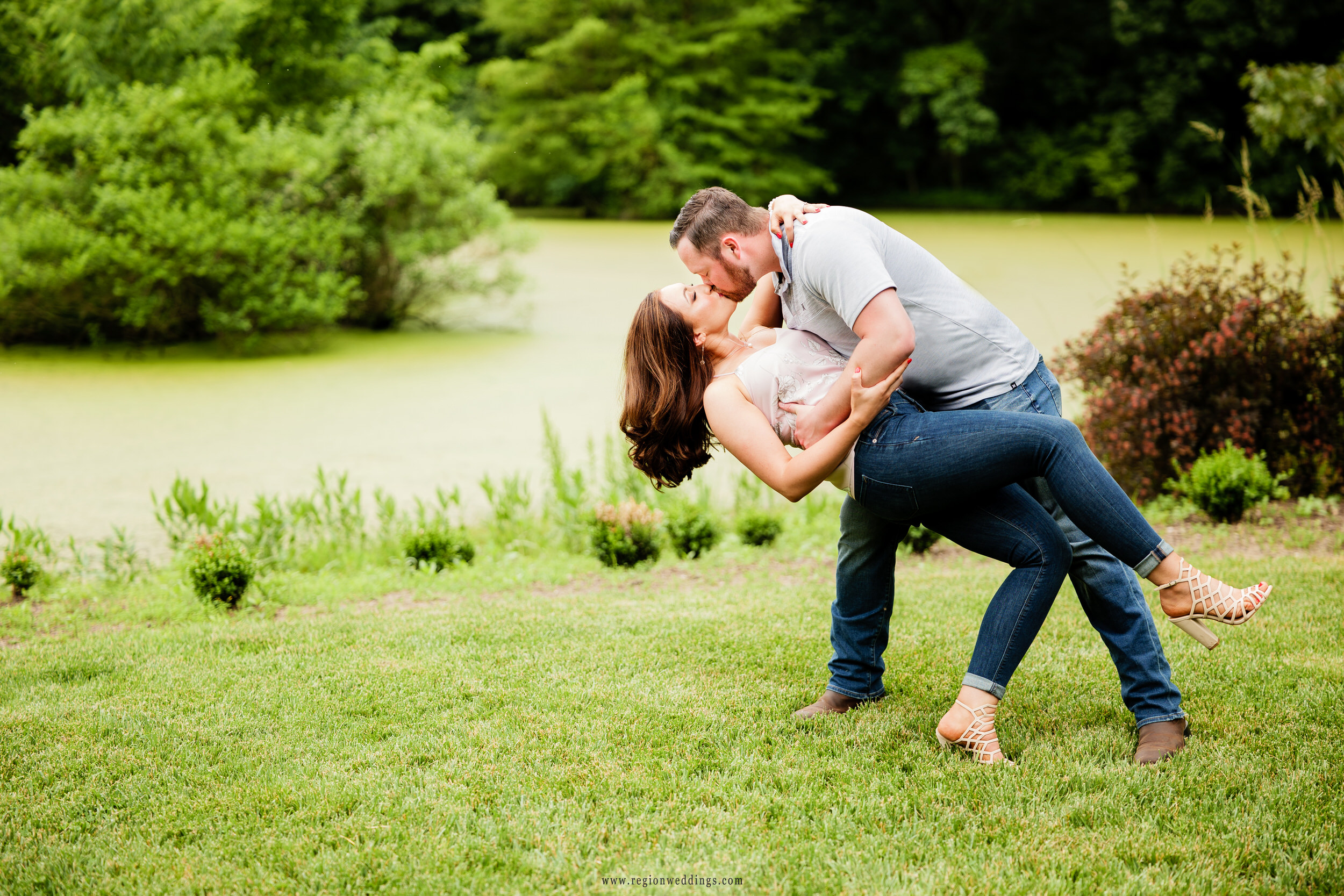 A kiss and dip in front of the lake at Gabis Arboretum.