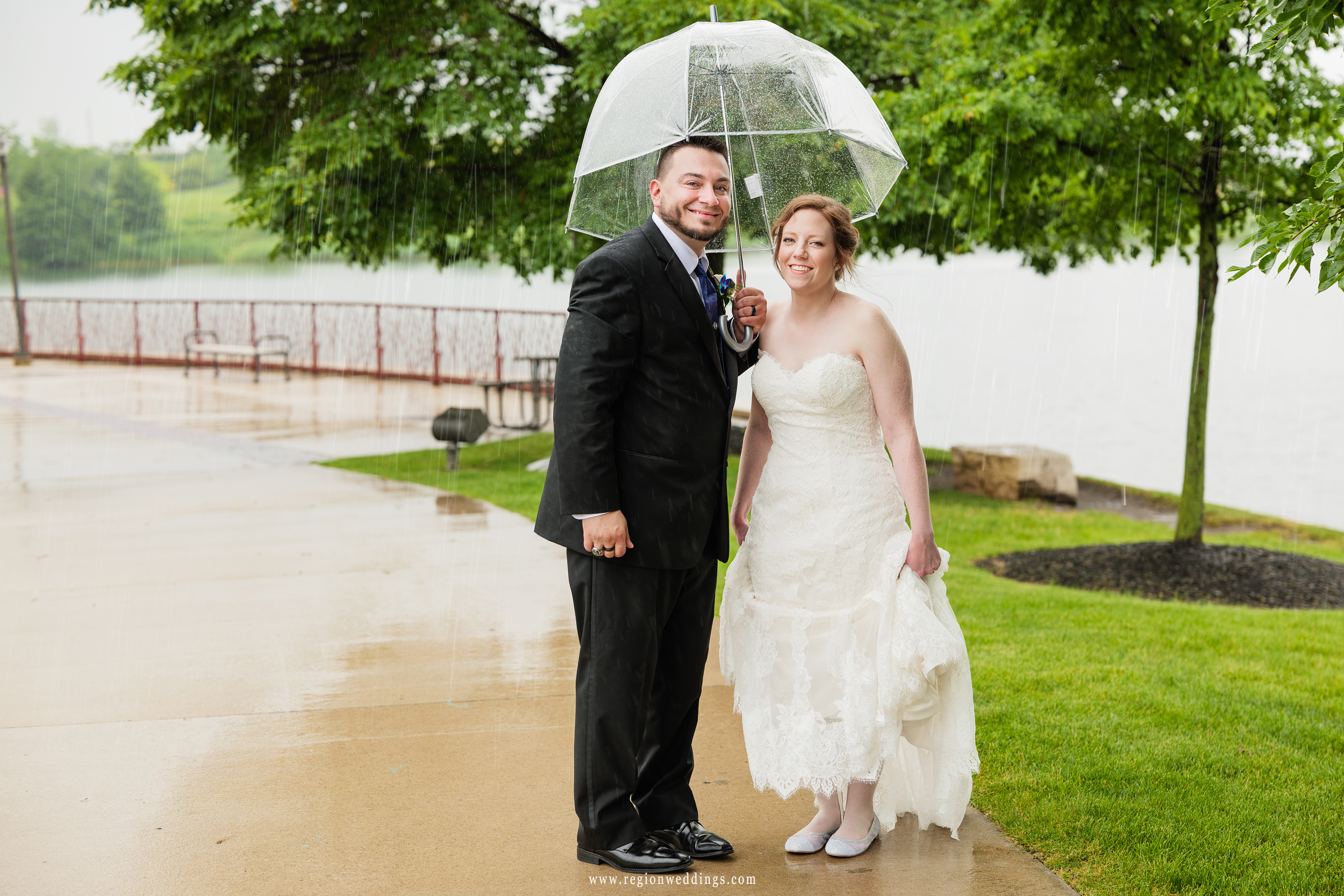 Newlyweds out in the summer rain at Centennial Park in Munster, Indiana.