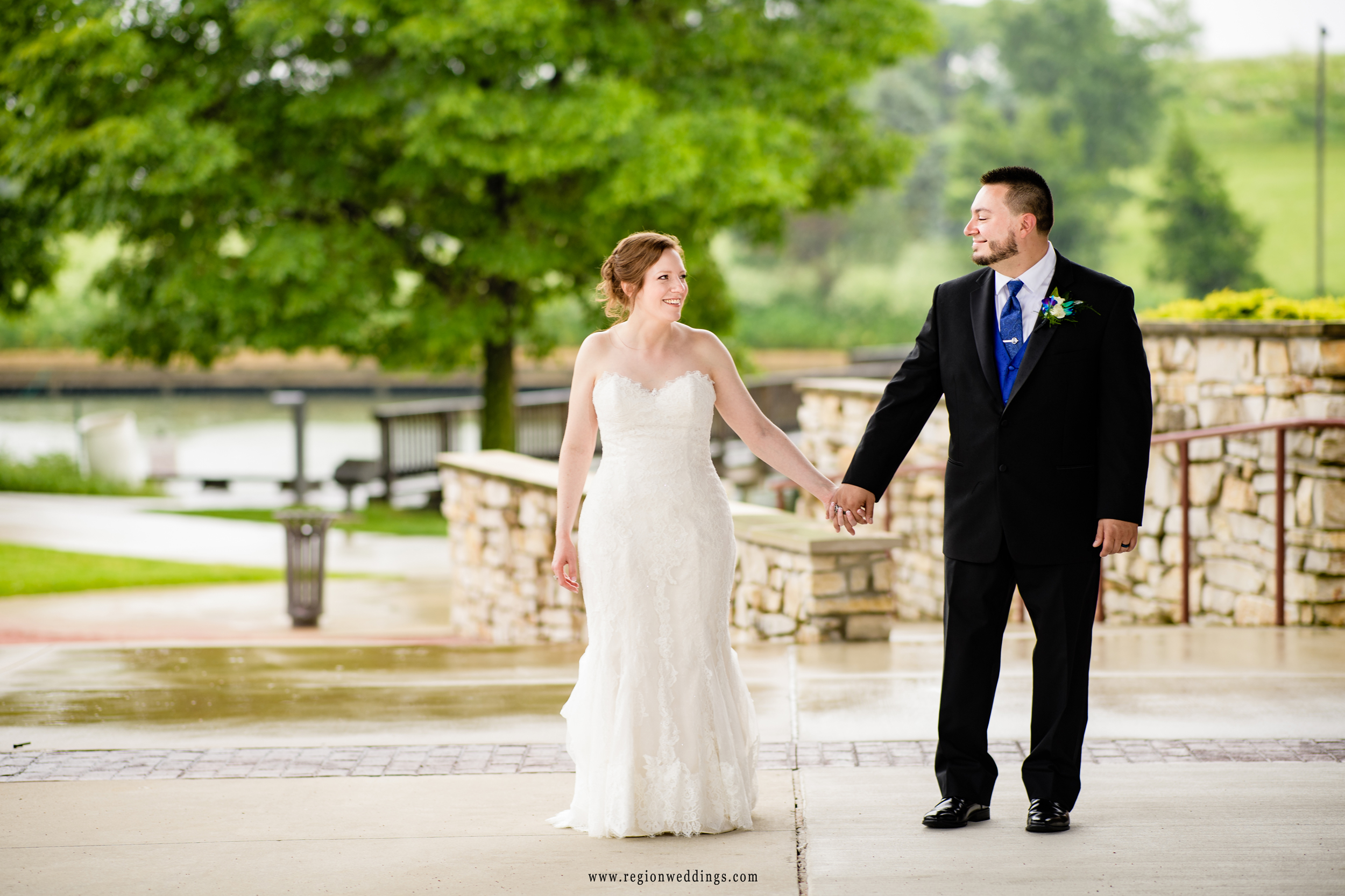 A romantic walk in the rain for the newlyweds.