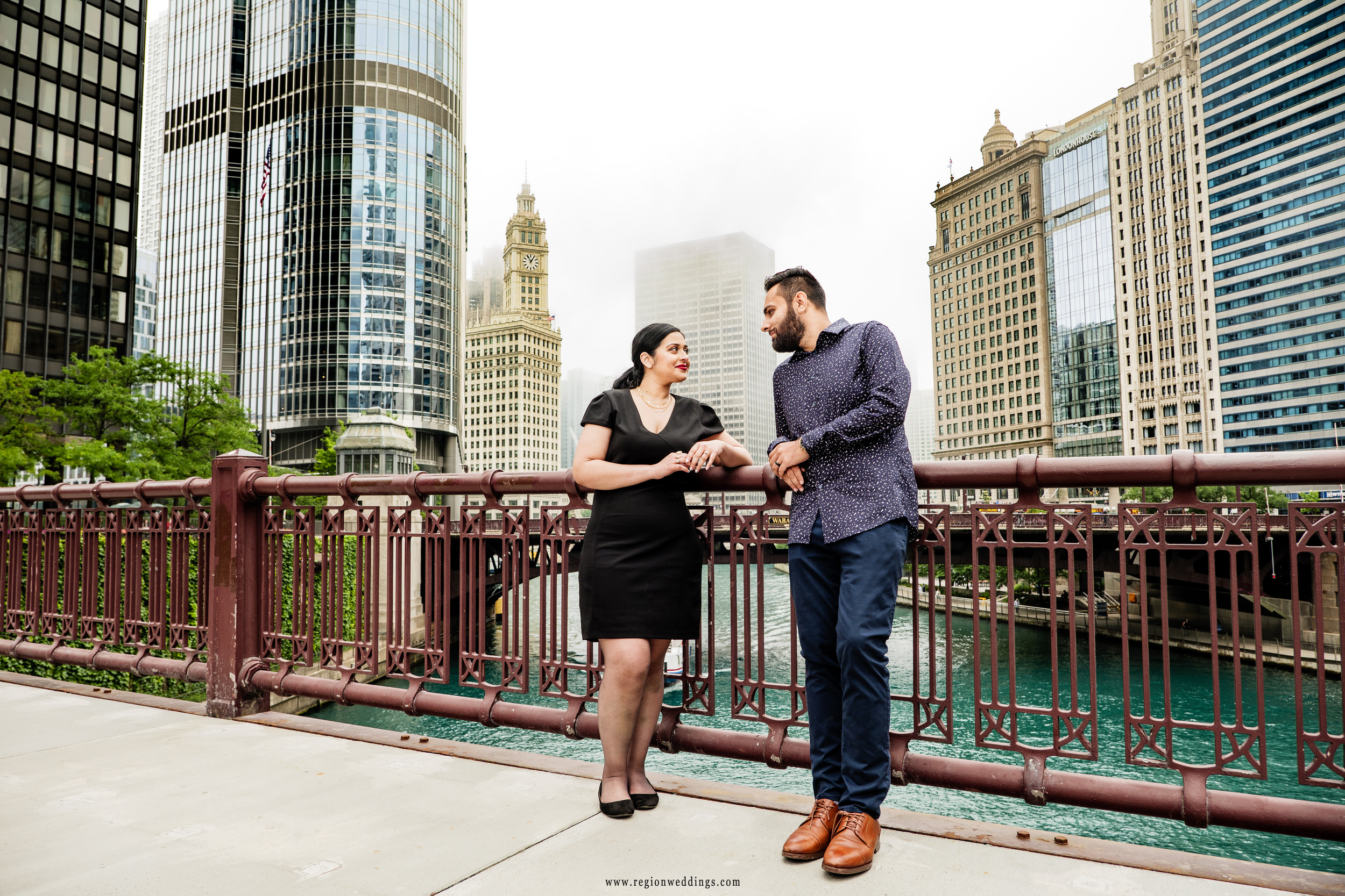 Engagement photo on the State Street bridge overlooking the Chicago River.