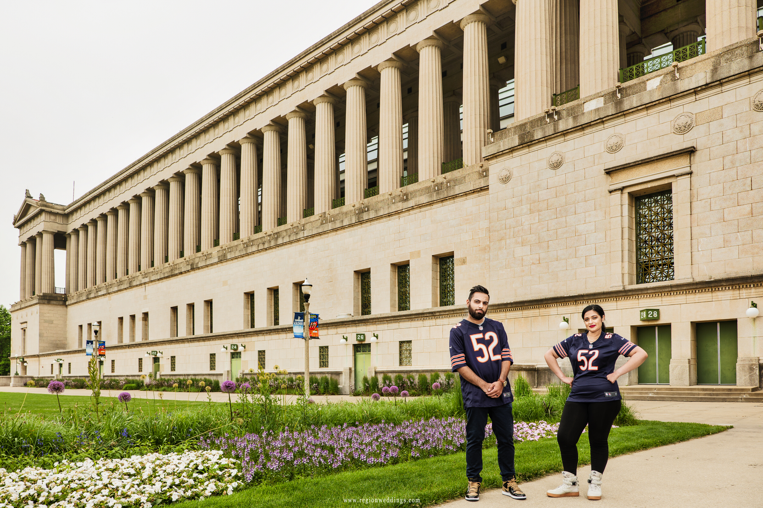 An engagement photo in Khalil Mack jerseys in front of Soldier Field.
