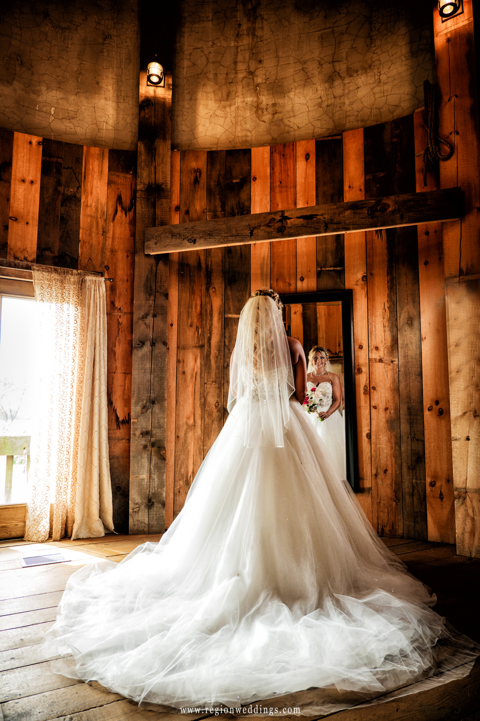 Bride in her flowing wedding dress inside the bridal suite at County Line Orchard.