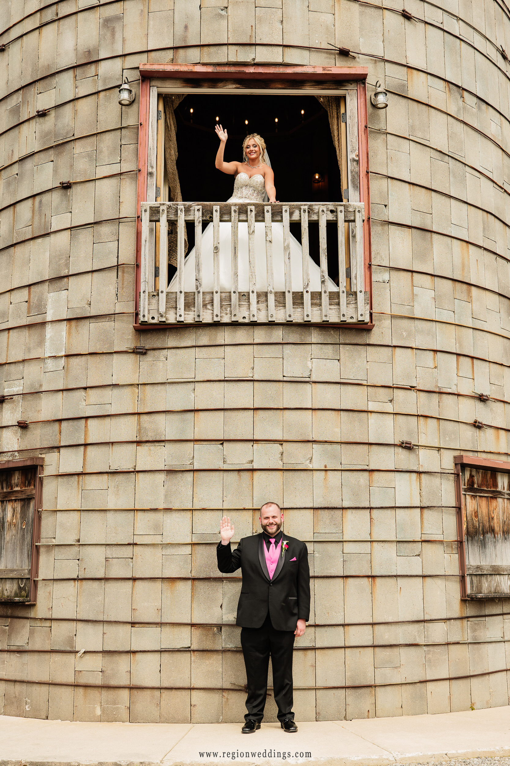 Bride and groom wave outside the grain silo at County Line Orchard.