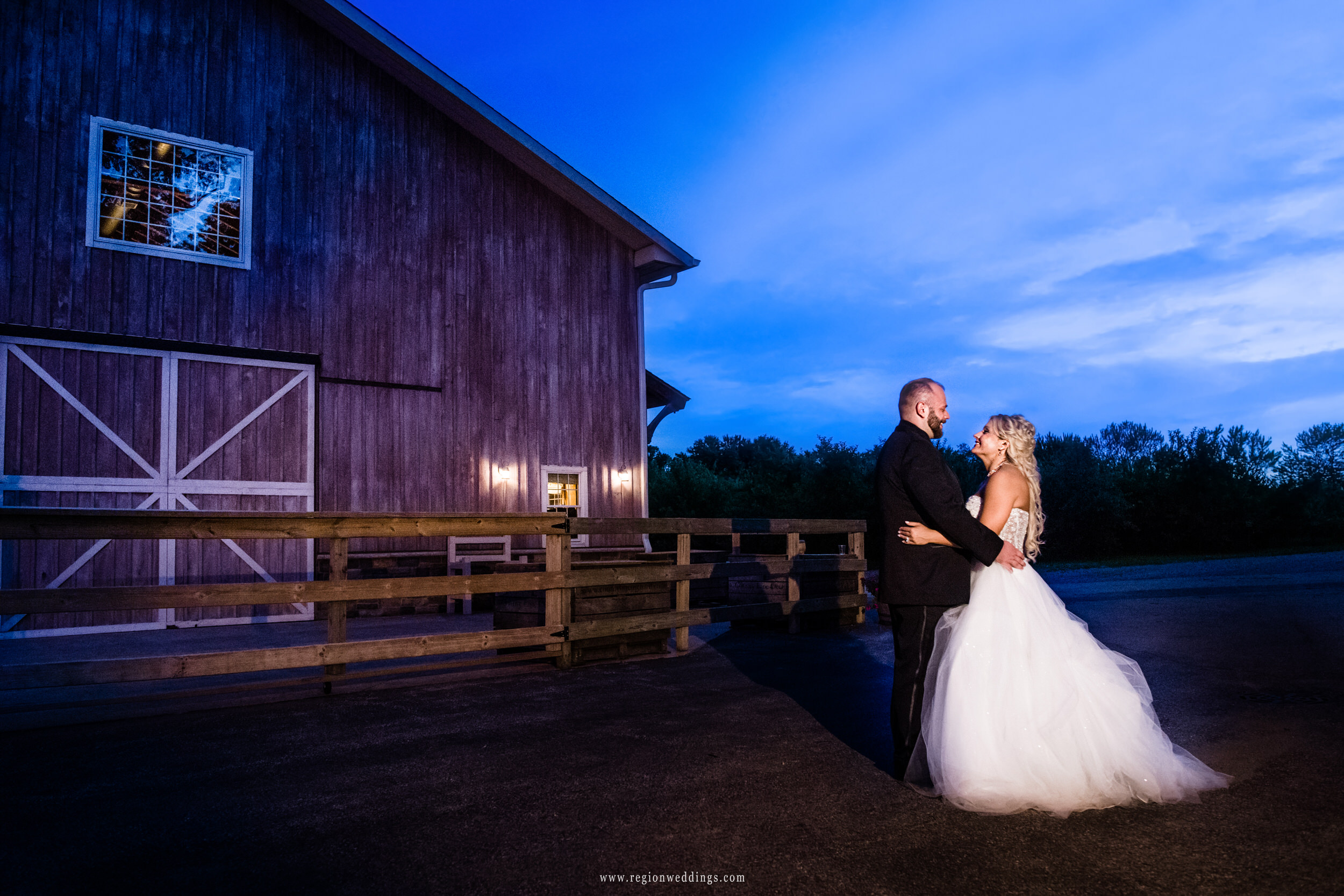 Night portrait of the bride and groom at County Line Orchard barn wedding venue.