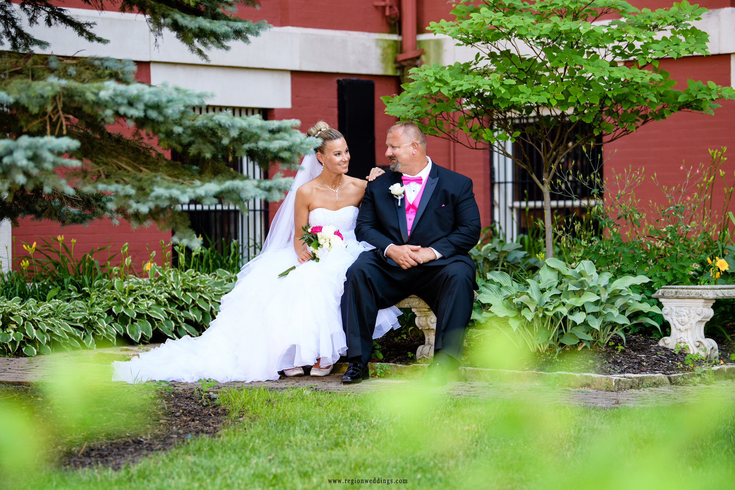 Bride and groom in the garden area of the Old Crown Point Courthouse.