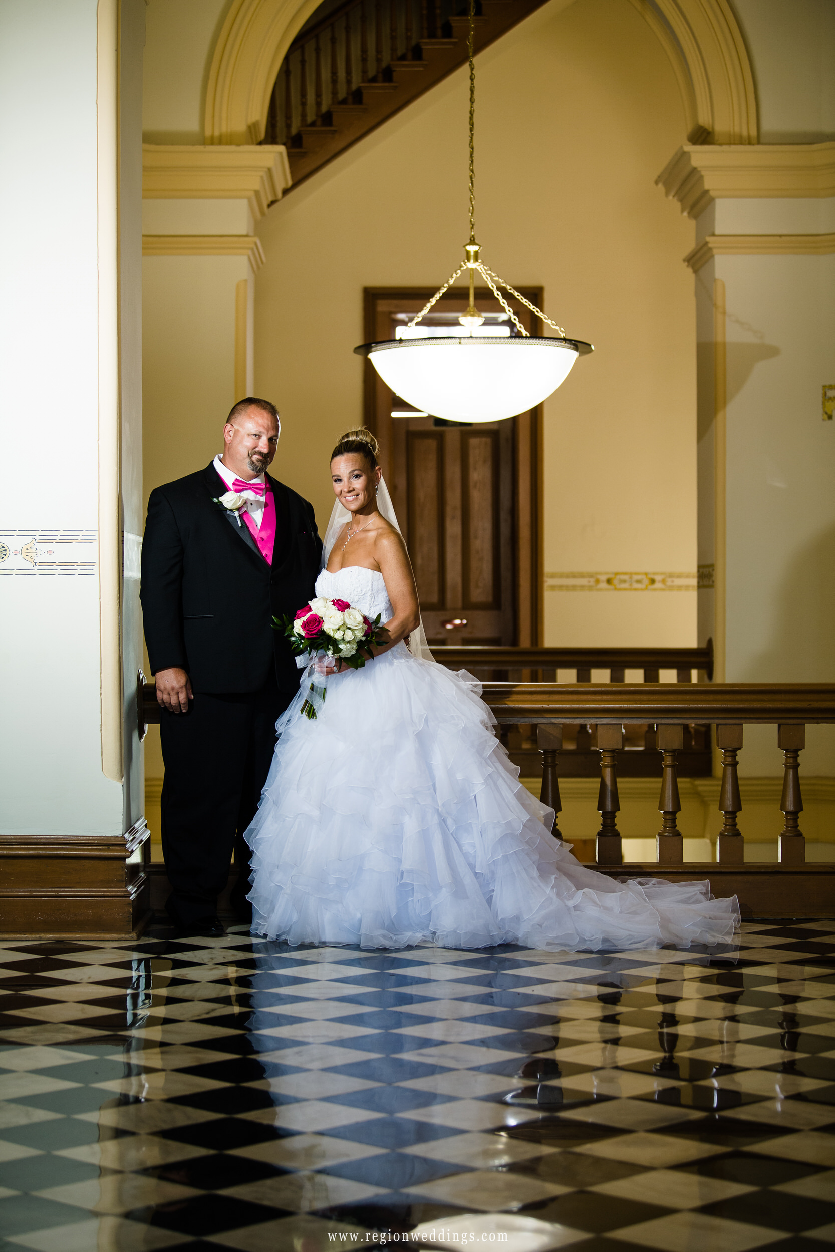Bride and groom portrait on the third floor of the old Crown Point Courthouse.