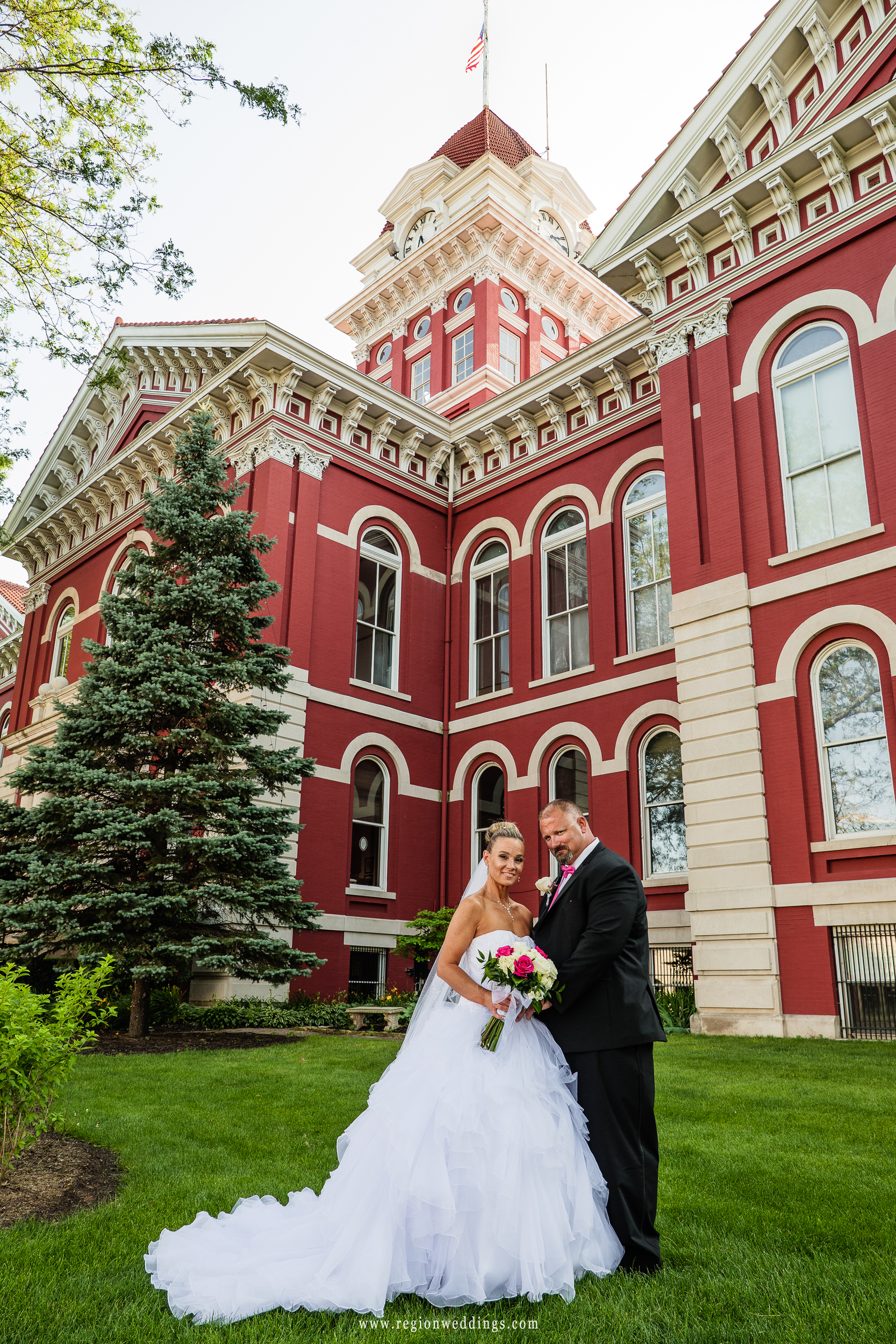 Wedding photo on the lawn of the historic Crown Point Courthouse.