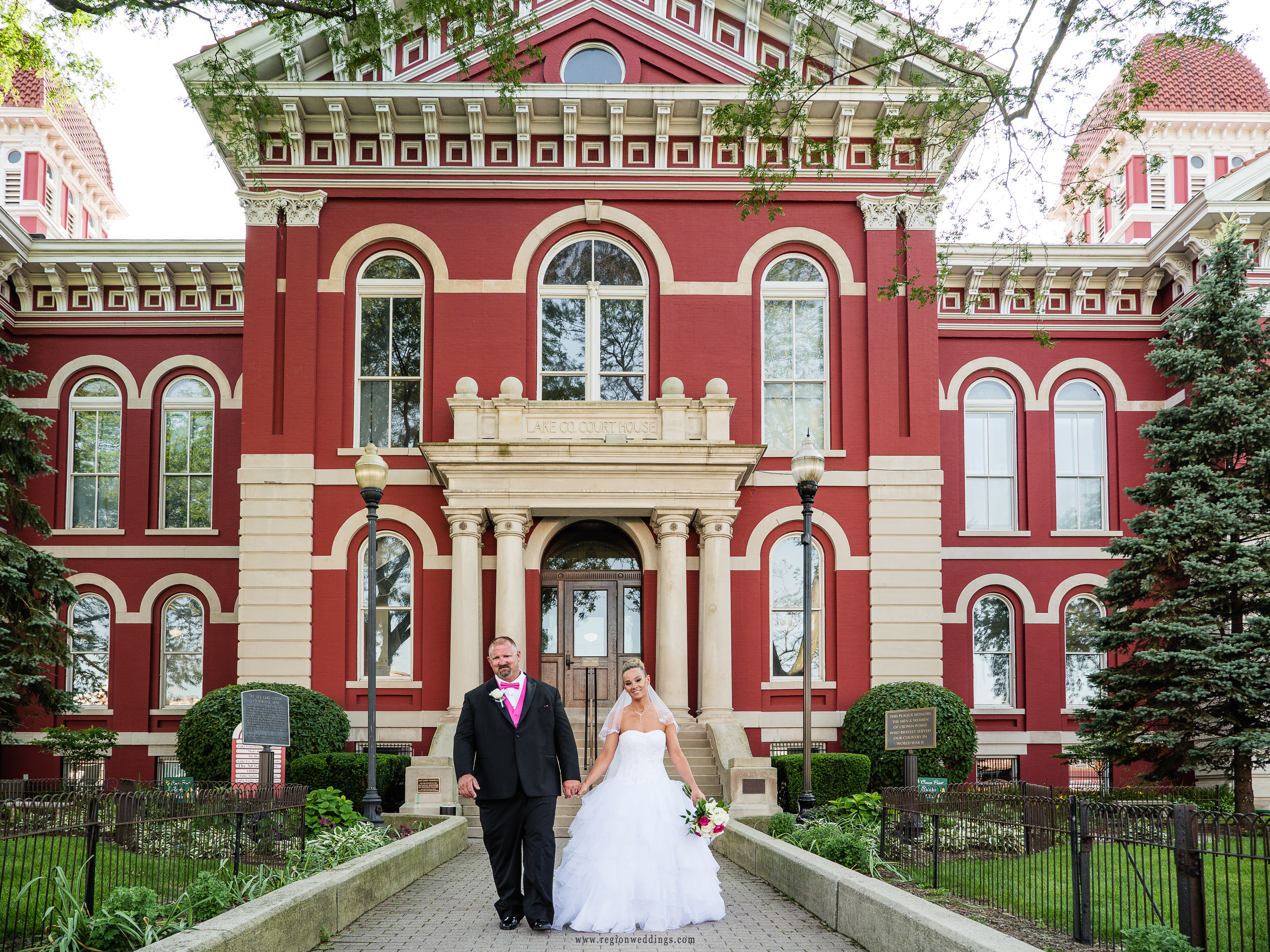 Bride and groom at the entrance of the historic Lake County Courthouse.