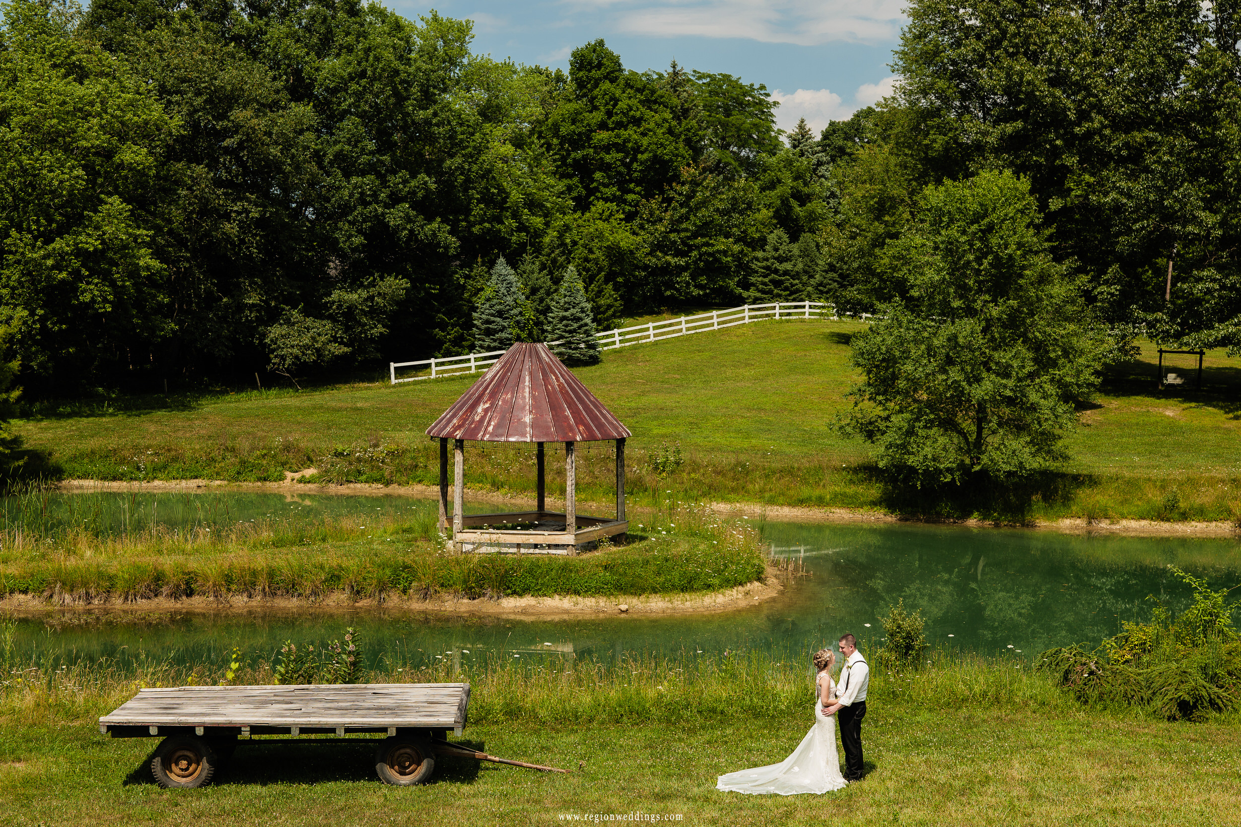 Bride and groom embrace on the sprawling grounds of Heston Hills in Laporte, Indiana