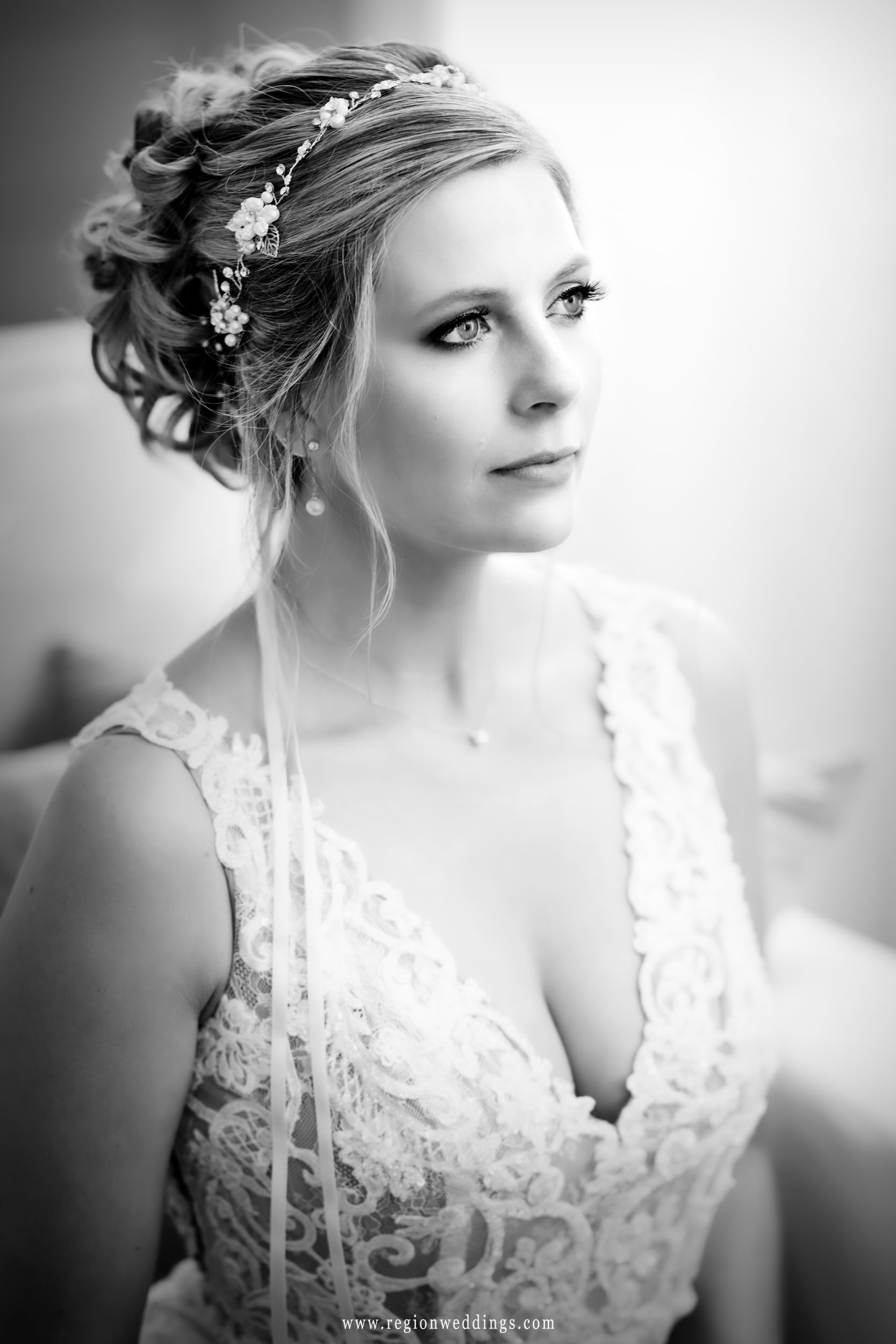 A classic black and white photo of the bride on her wedding day.