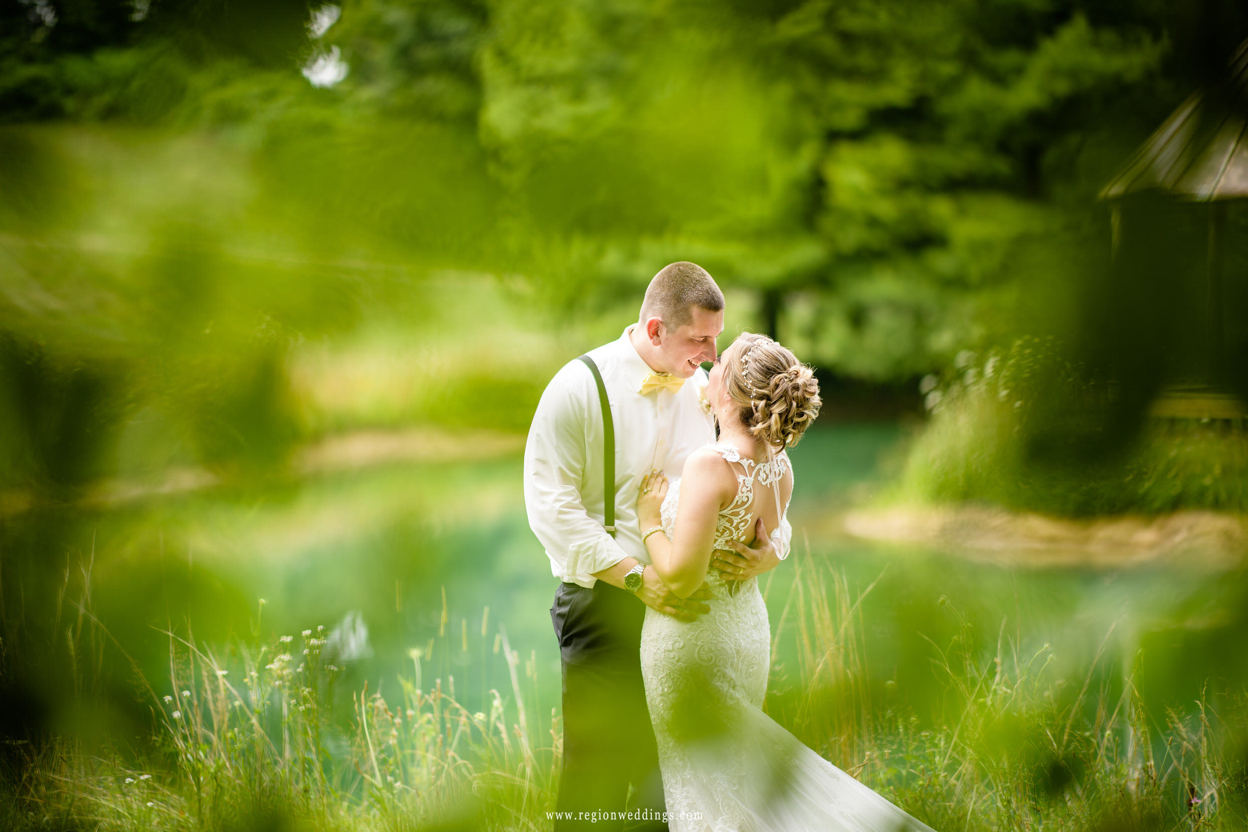 The bride and groom surrounded by swirling greenery at Heston Hills.