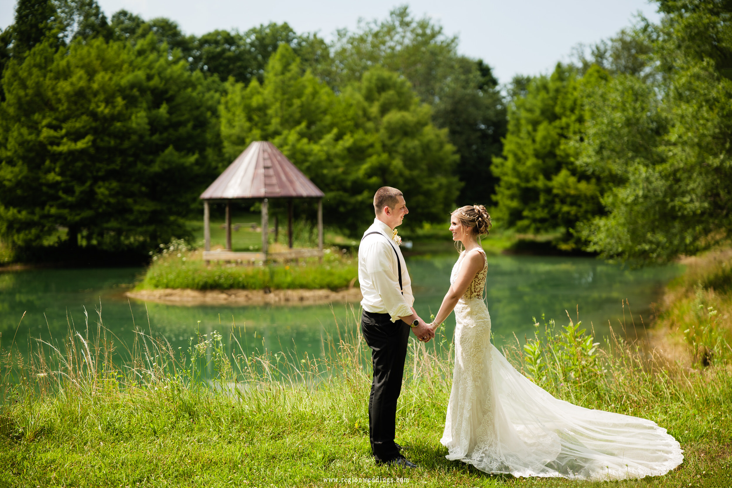 Bride and groom in front of the lakeside gazebo at Heston Hills Event Center in Laporte, Indiana.