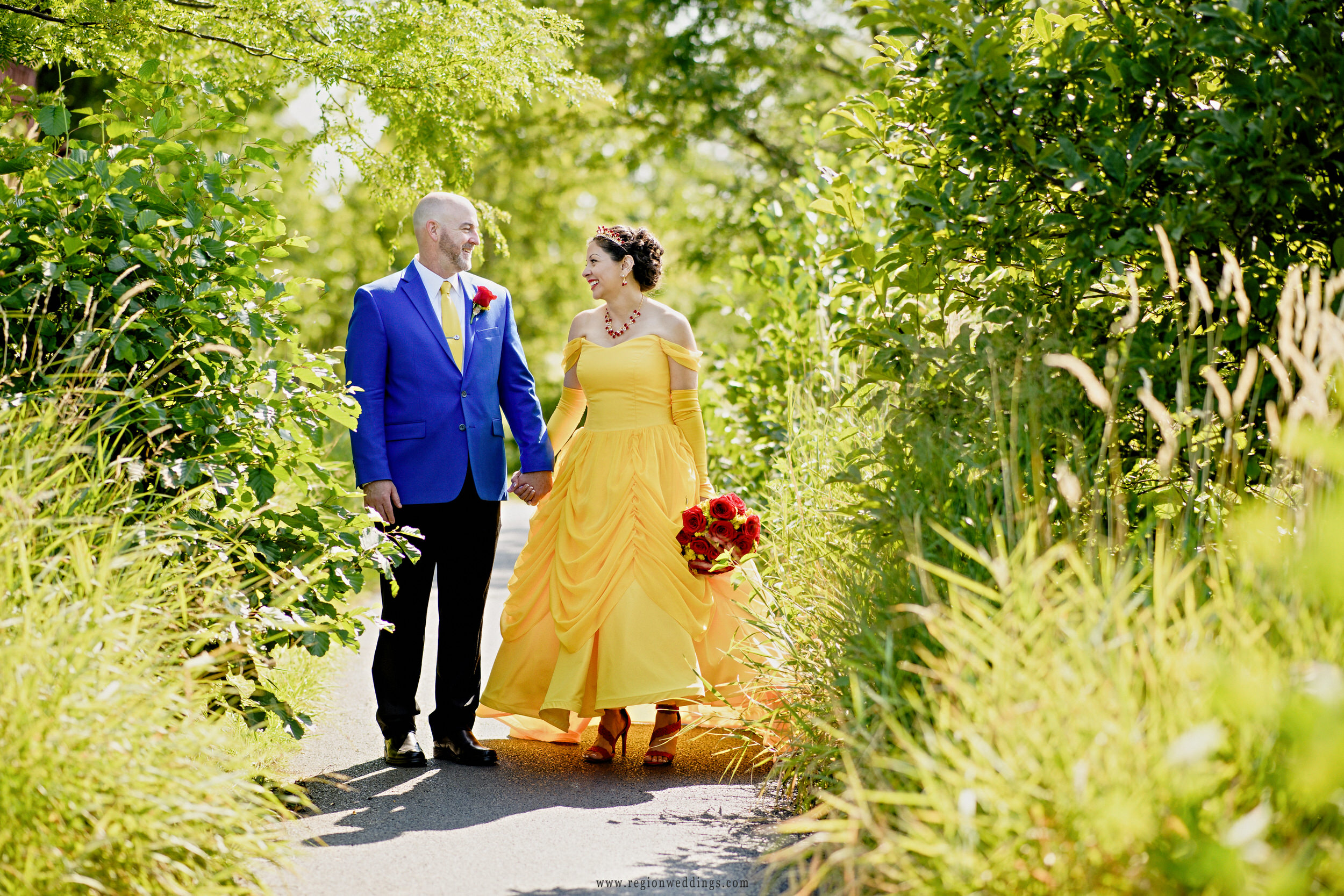 Bride and groom take a stroll during their Disney themed wedding.