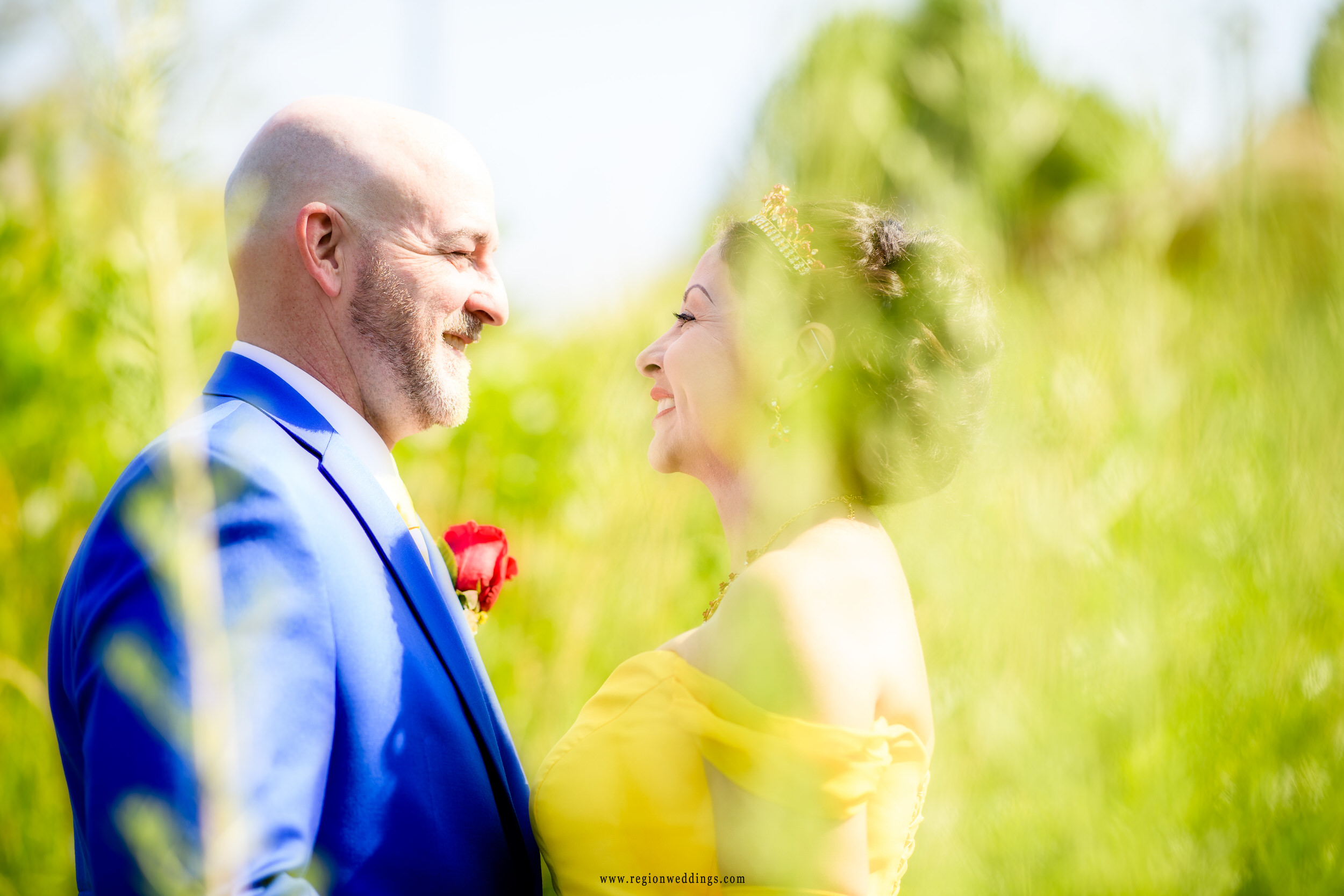 Romantic gaze of the bride and groom during their summer wedding portraits.