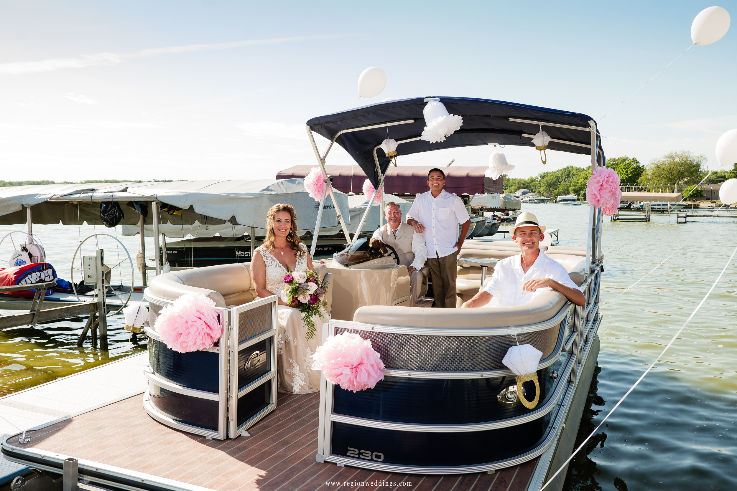 The bride boards a boat that will take her to her wedding ceremony.