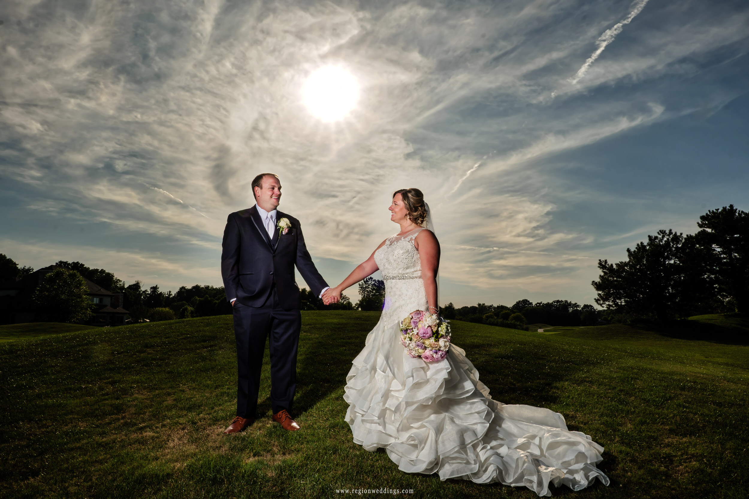 The sun shines upon the newlyweds at Sand Creek Golf Course in Schererville, Indiana.