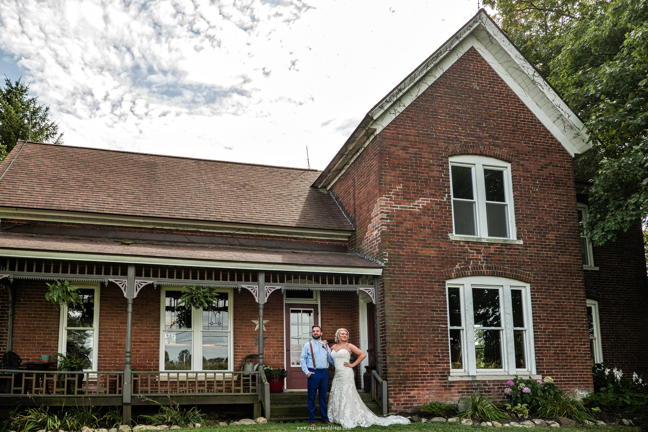 Bride and groom in front of the historic building at Four Corners Winery in Valparaiso, Indiana.