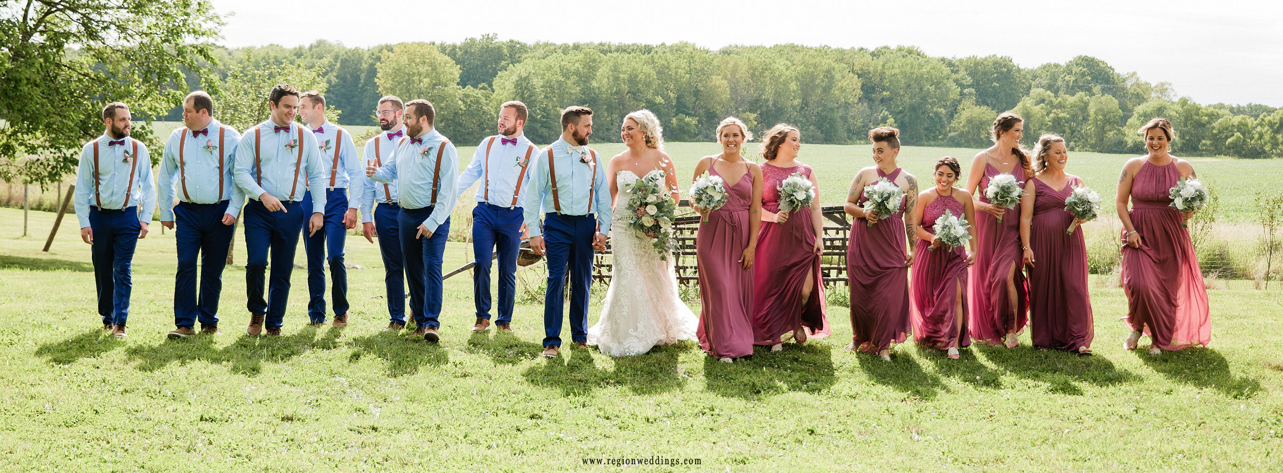 The wedding party takes a walk through the fields at Four Corners Winery.