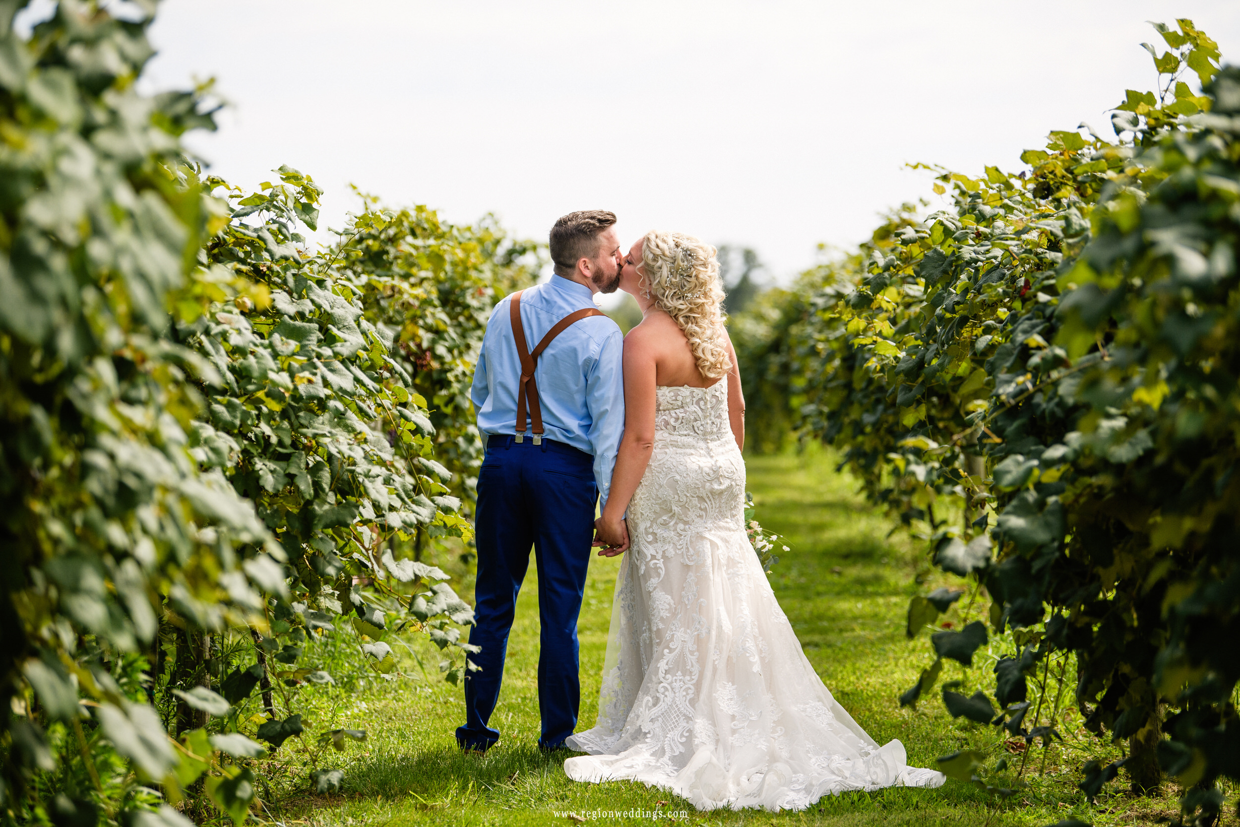 Kissing between the grape orchards at Four Corners Winery.