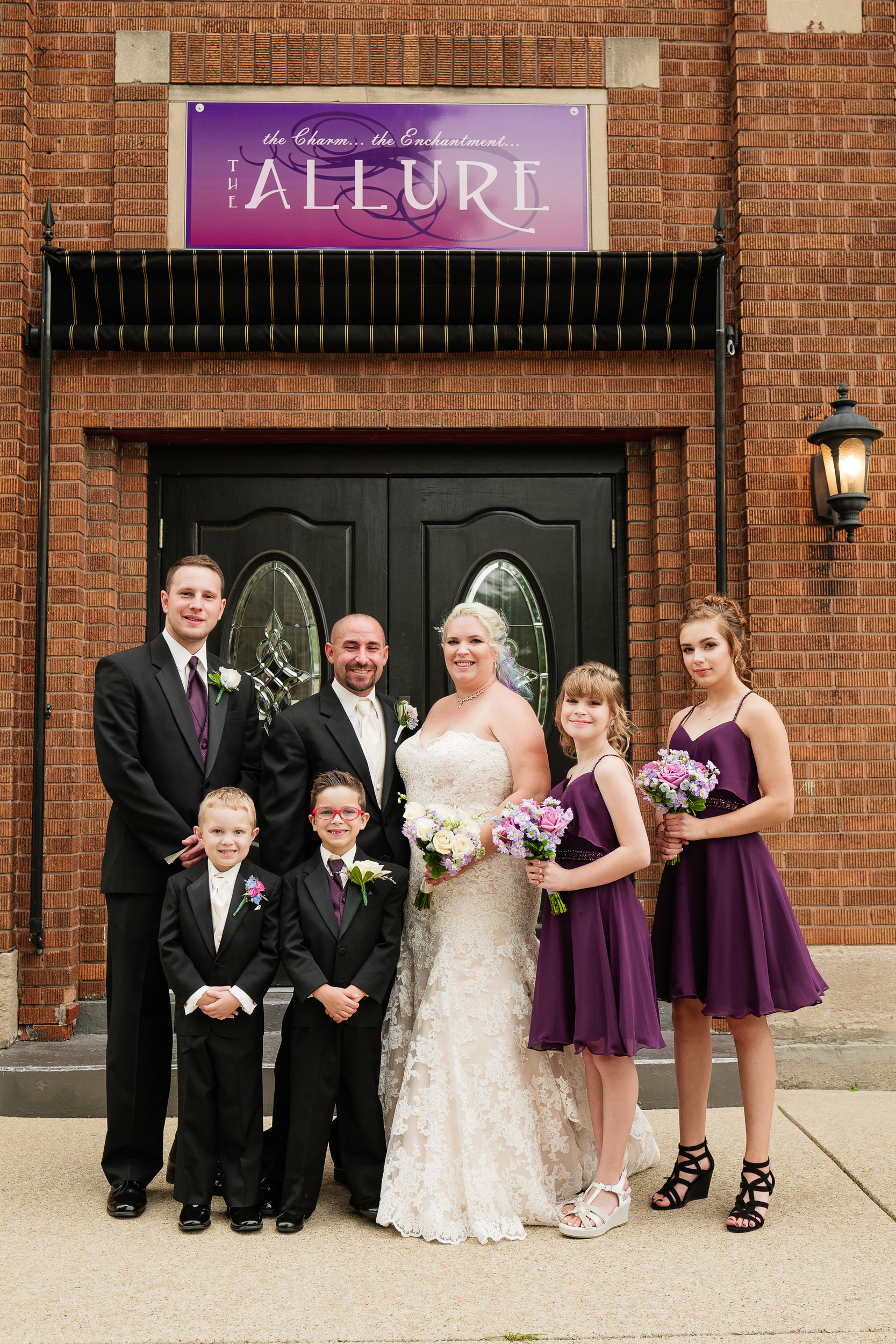 Wedding party at the entrance of The Allure wedding venue.