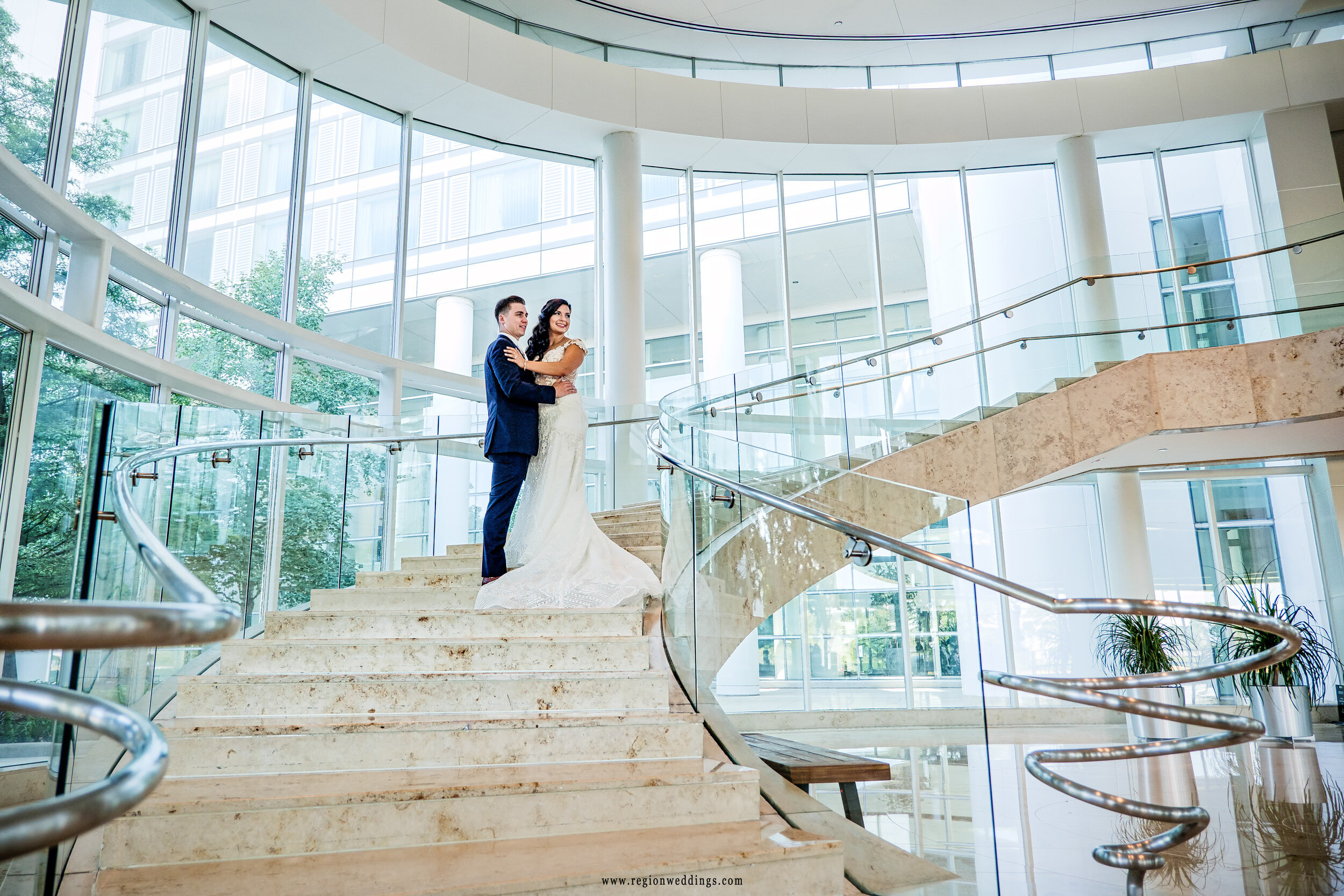 Bride and groom on the staircase at The Renaissance in Schaumburg.