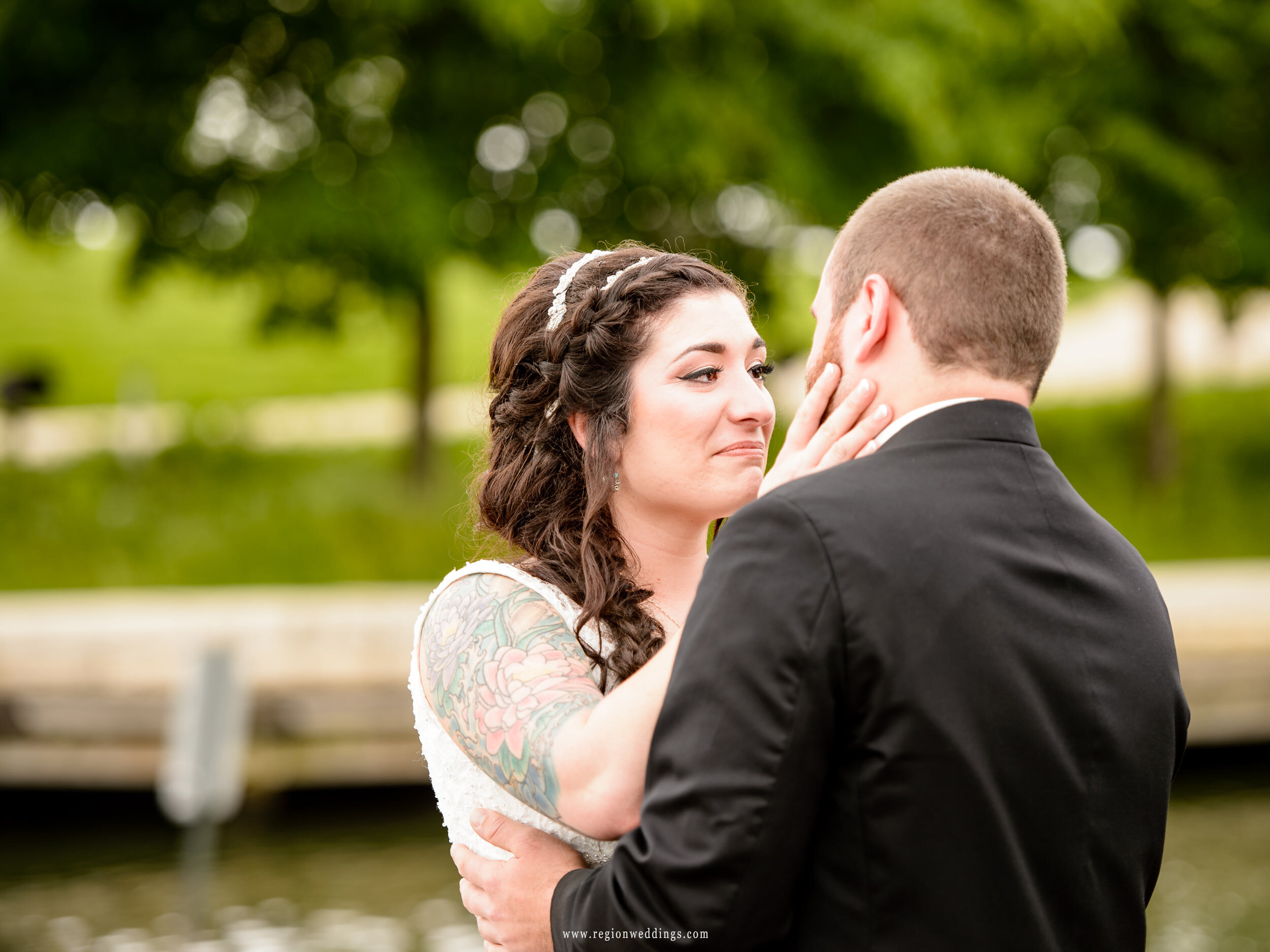 Bride and groom come together during an emotional moment.