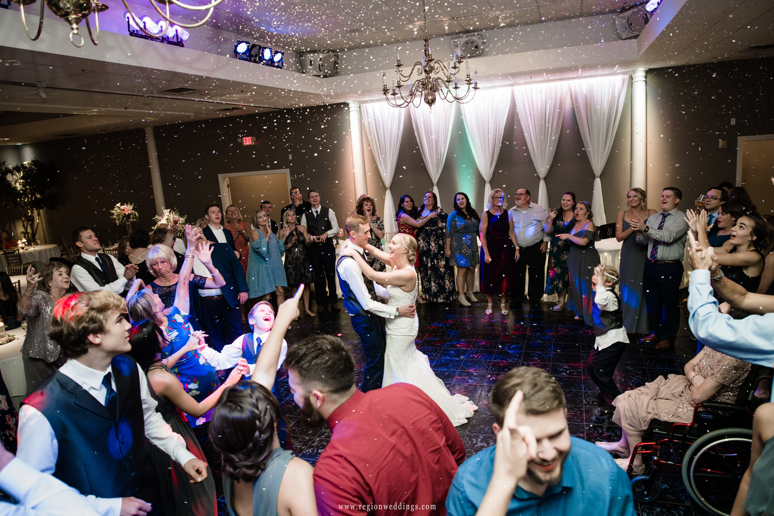 Snow hits the dance floor during a wedding reception at Aberdeen Manor Ballroom.